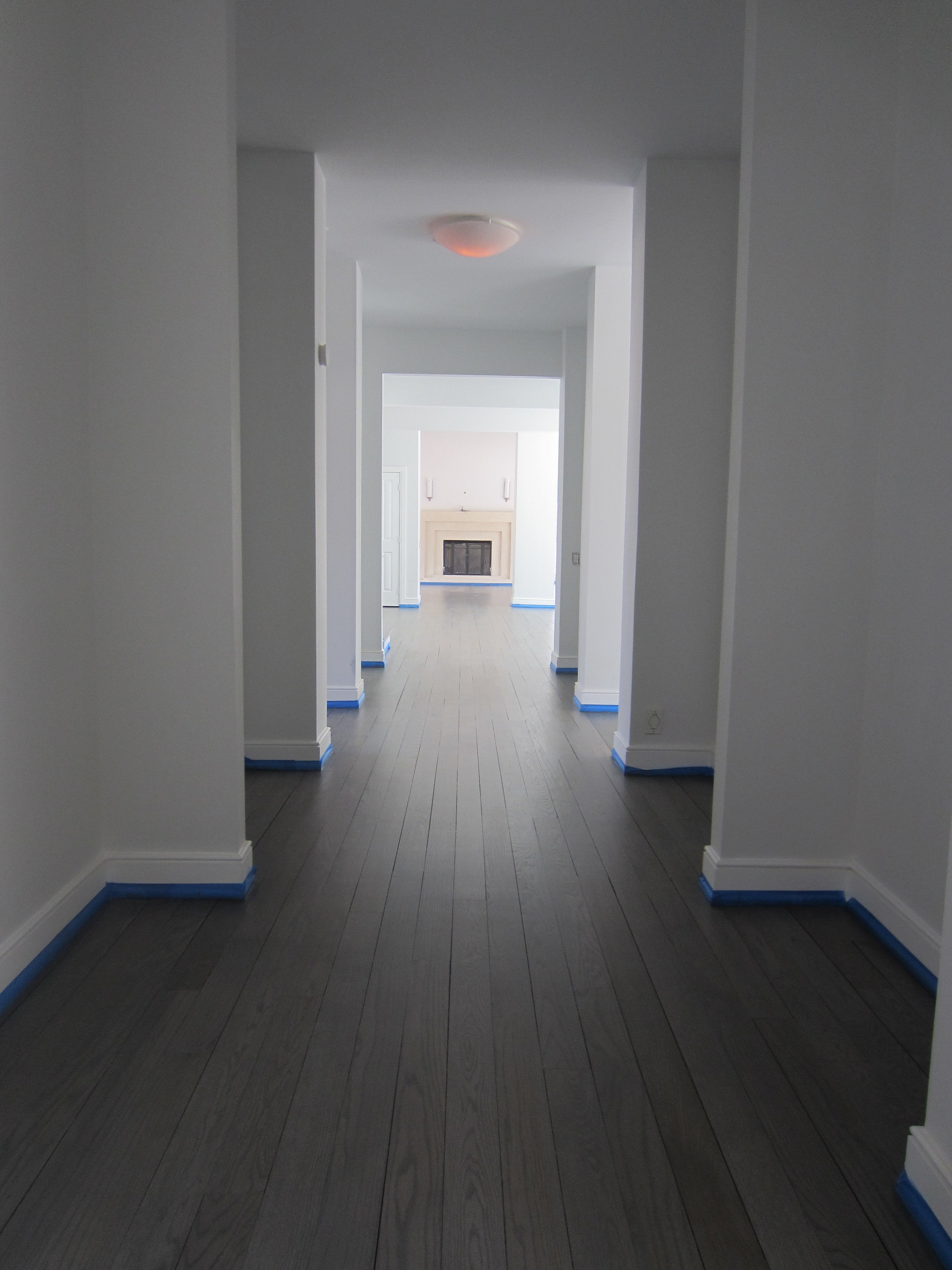 """This is a stunning home we sanded and finished in Sagaponack, NY. The homeowner inherited these 4"""" Red Oak hardwood floors when the home was purchased. Note that climate controls were turned off in the winter prior to our arrival in Spring and the floor exhibits significant gapping."""