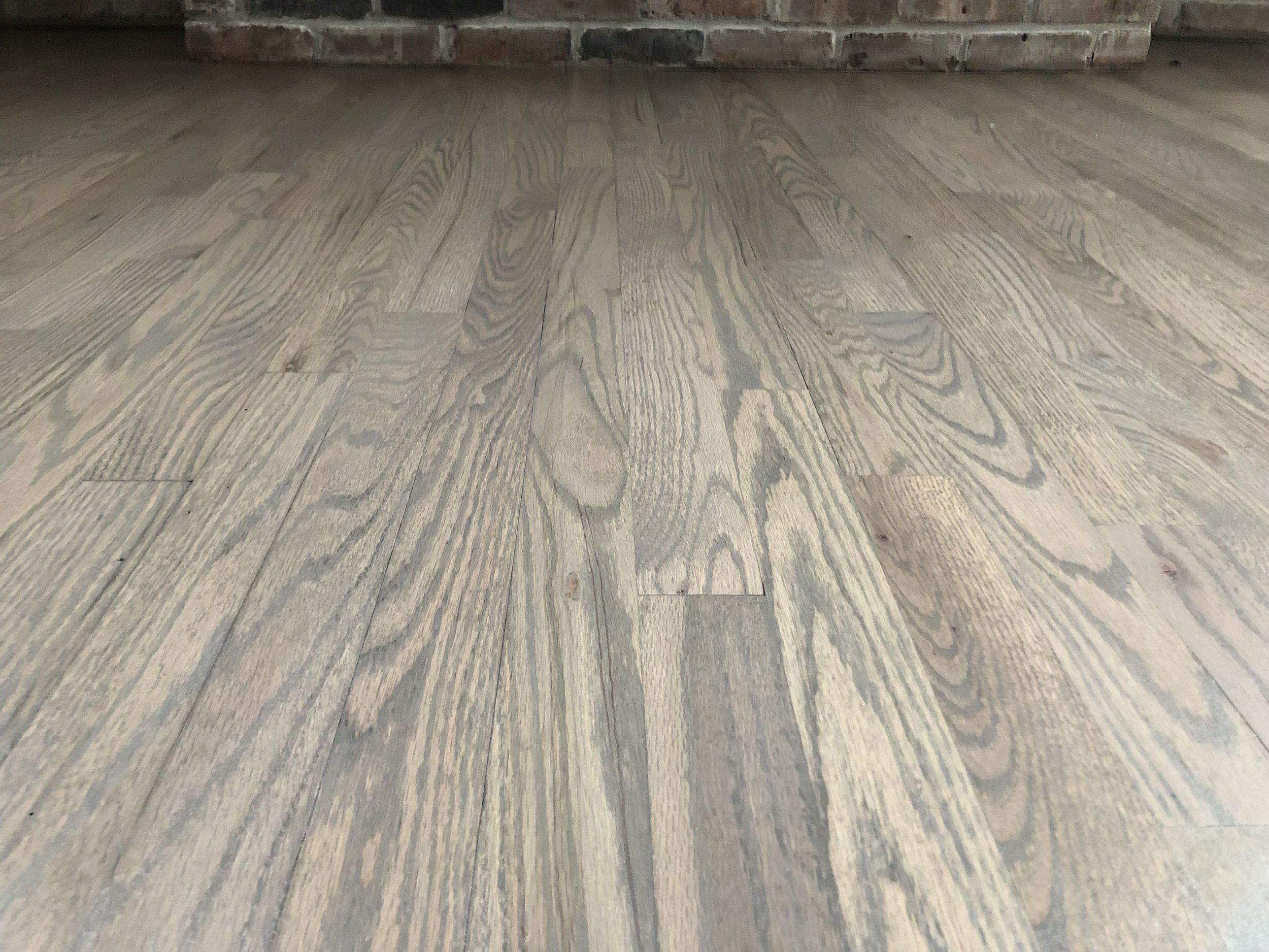 3-color custom blend on Red Oak for a customer in Huntington, NY 2018. Finished with Bona Traffic HD. This lighter, softer gray imparts more of a driftwood tone.