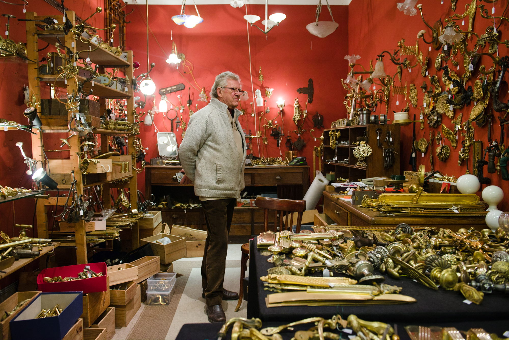 Jean-Pierre Jankovsky, Marché Serpette - Allée 6, Stand 6  Jean-Pierre specializes in antique doorknobs and handles as well as everything else associated with them, he has run his stand for 32 years.  PHOTOGRAPHY: William Lounsbury • Nikon D800 • AF-S NIKKOR 24-70mm Ƒ/2.8G ED @ 27MM • Ƒ/4 • 1/40 • ISO 800