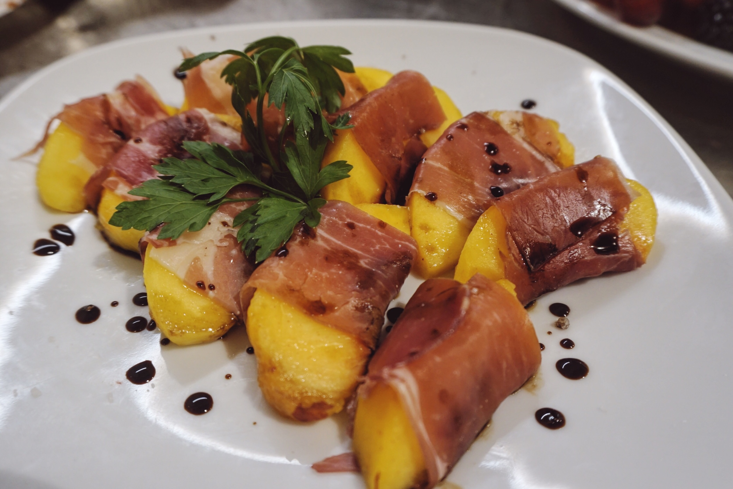 proscuitto wrapped peaches with balsamic vinegar