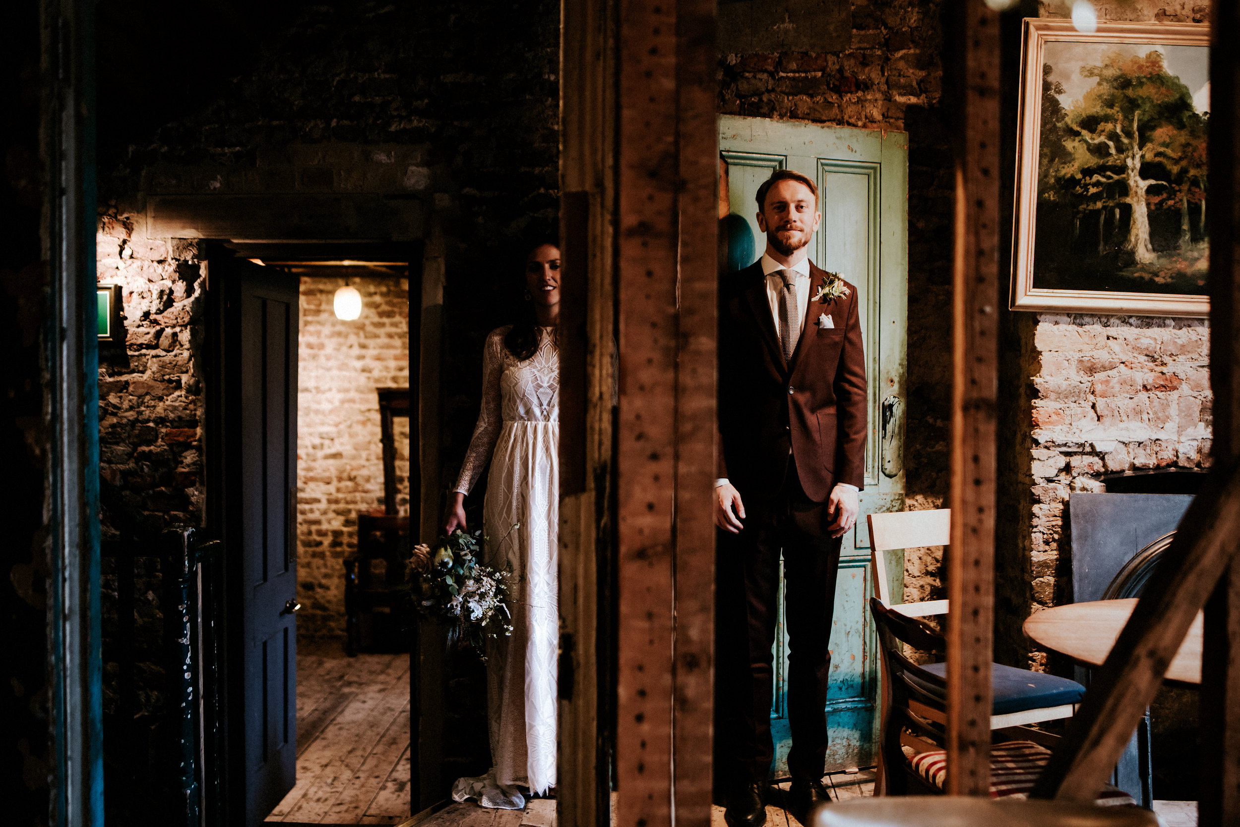 Love takes centre stage in this fairy lit pi�ata swinging urban wedding at Wiltons Music Hall in London.