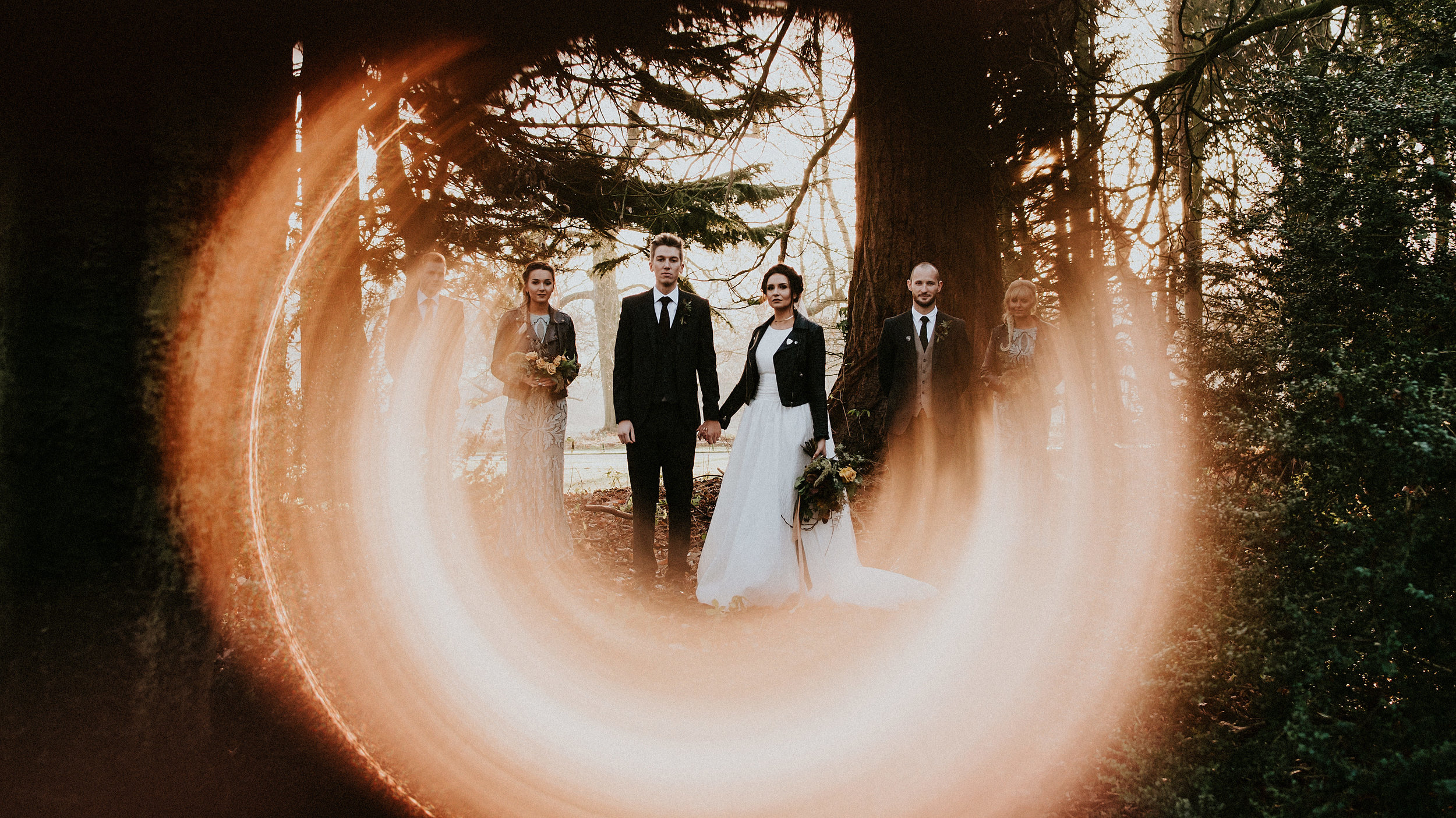Beautiful floral design from Firenza Flowers, Leather Jackets & Low Winter Sun in this spell bound Winter Wedding at Hazlewood Castle.