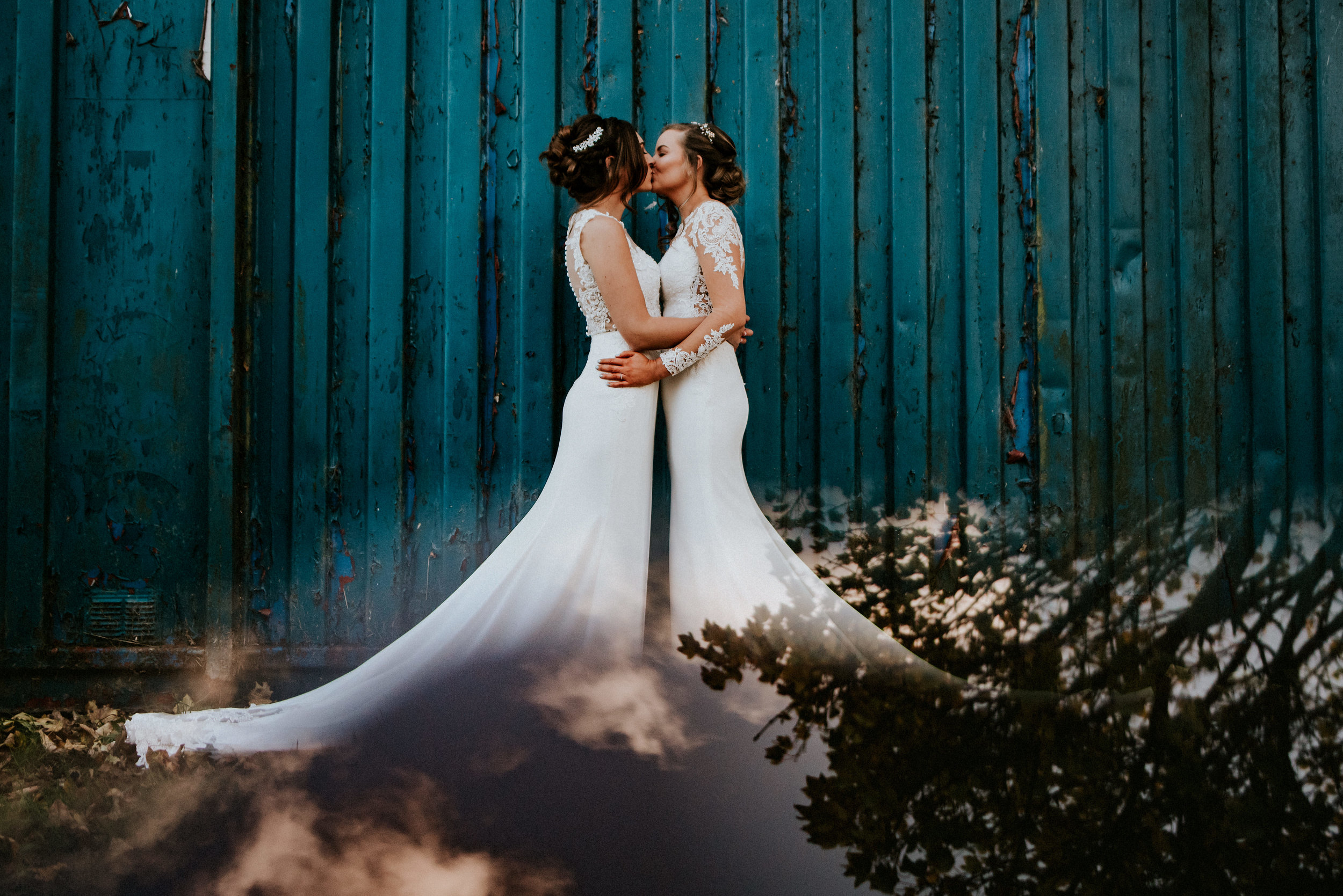 A Wakefield wedding at Lakeside Ponderosa with two brides. Zoo animals & two beautiful dresses, braving the cold in creative portraits amidst eclectic grounds