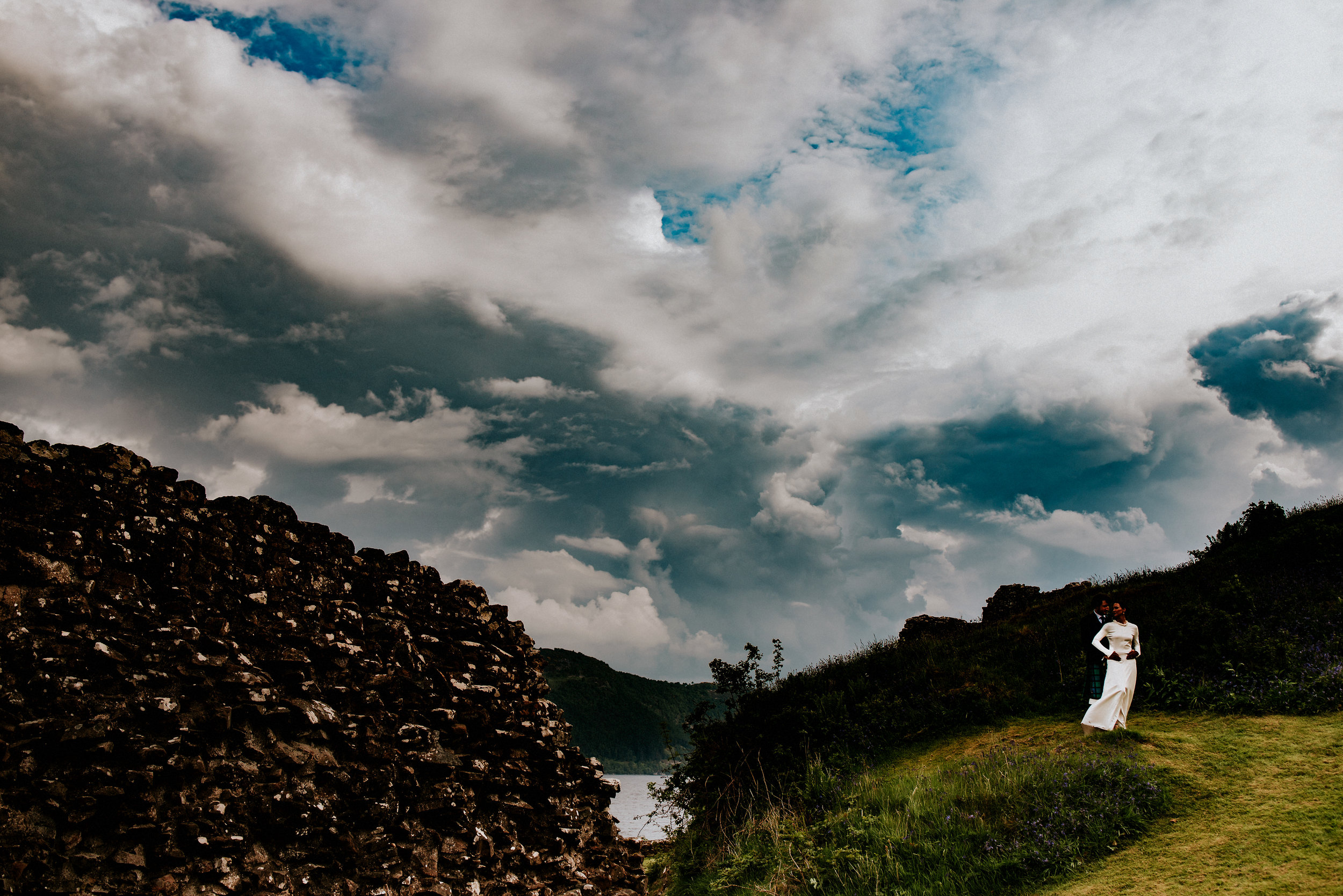 Epic Scottish landscapes, An outdoor wedding ceremony amidst the awe inspiring Urquhart Castle. A river boat cruise, From kilts to confetti explosions in this atmospheric alternative Loch Ness wedding