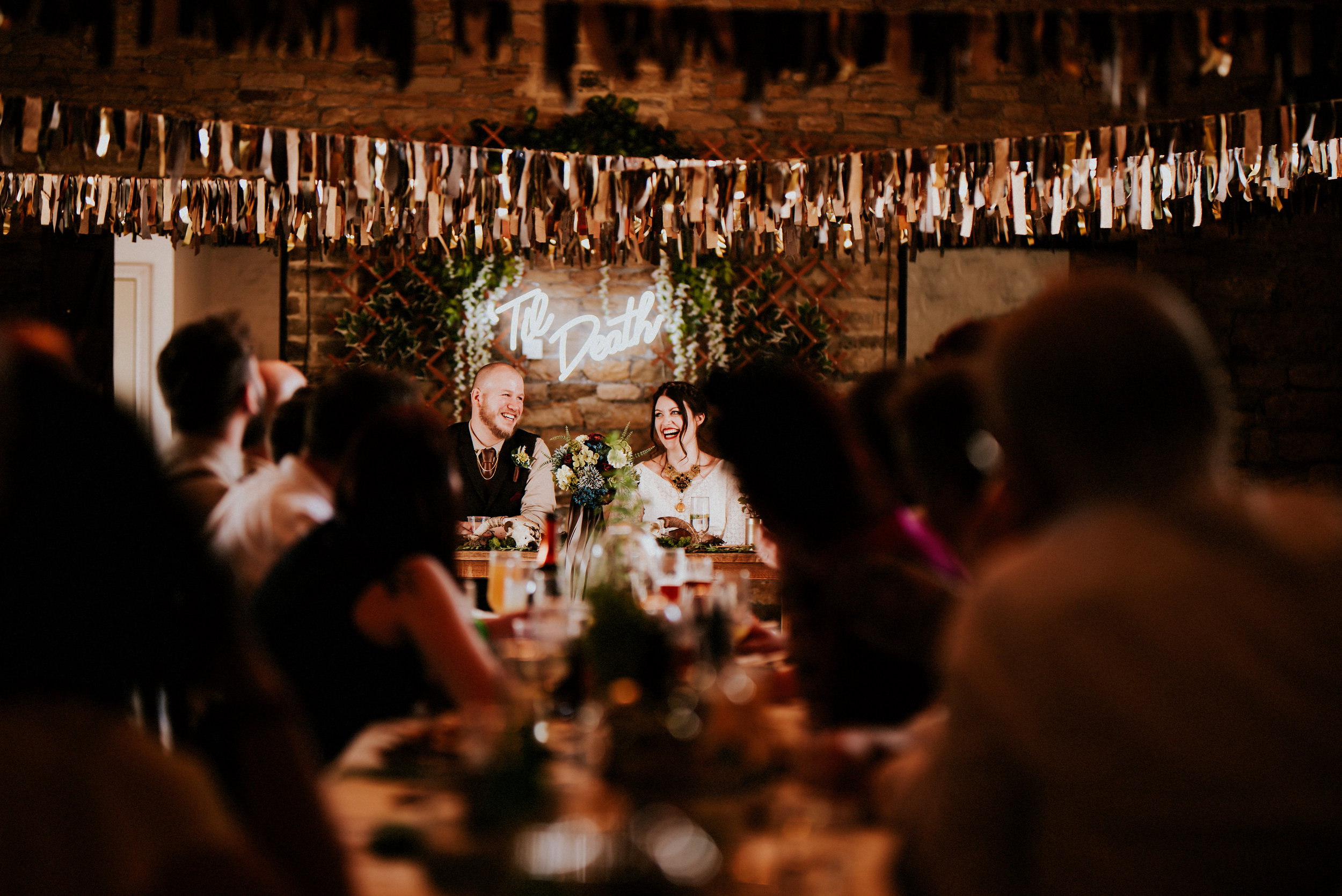Handmade decorations, Birds of Prey, A beautiful lace dress from Rolling in Roses. The awe inspiring grandeur of Oakwell Hall in Birstall is the ideal venue for this neon lit rock n roll Leeds wedding