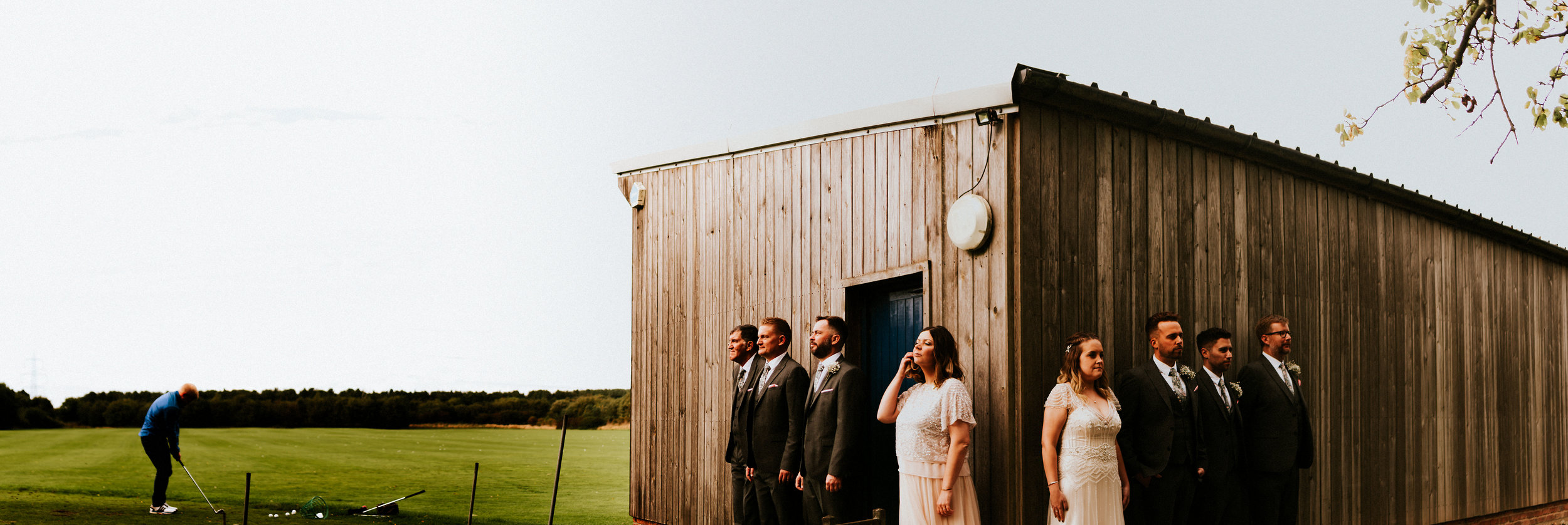 A tale of two brides in the beautiful wooden beamed barn venue of Sandburn Hall. Golf club portraits, Fairy lit first dances & a love without compare for Kaity & Charlotte's York wedding