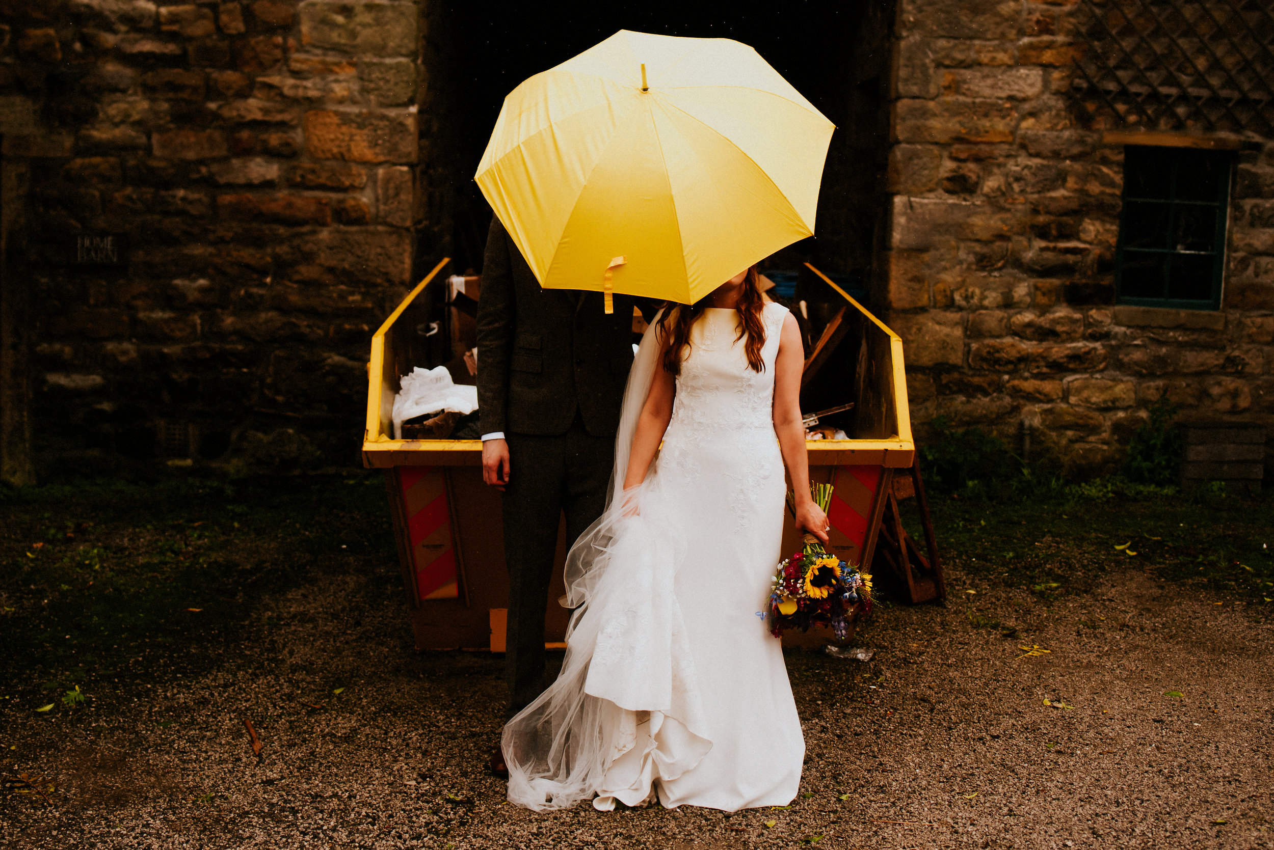 Rainfall & primary colours meet bleak Yorkshire Dales Landscapes in this Red Lion Burnsall wedding with Rosie & Scott