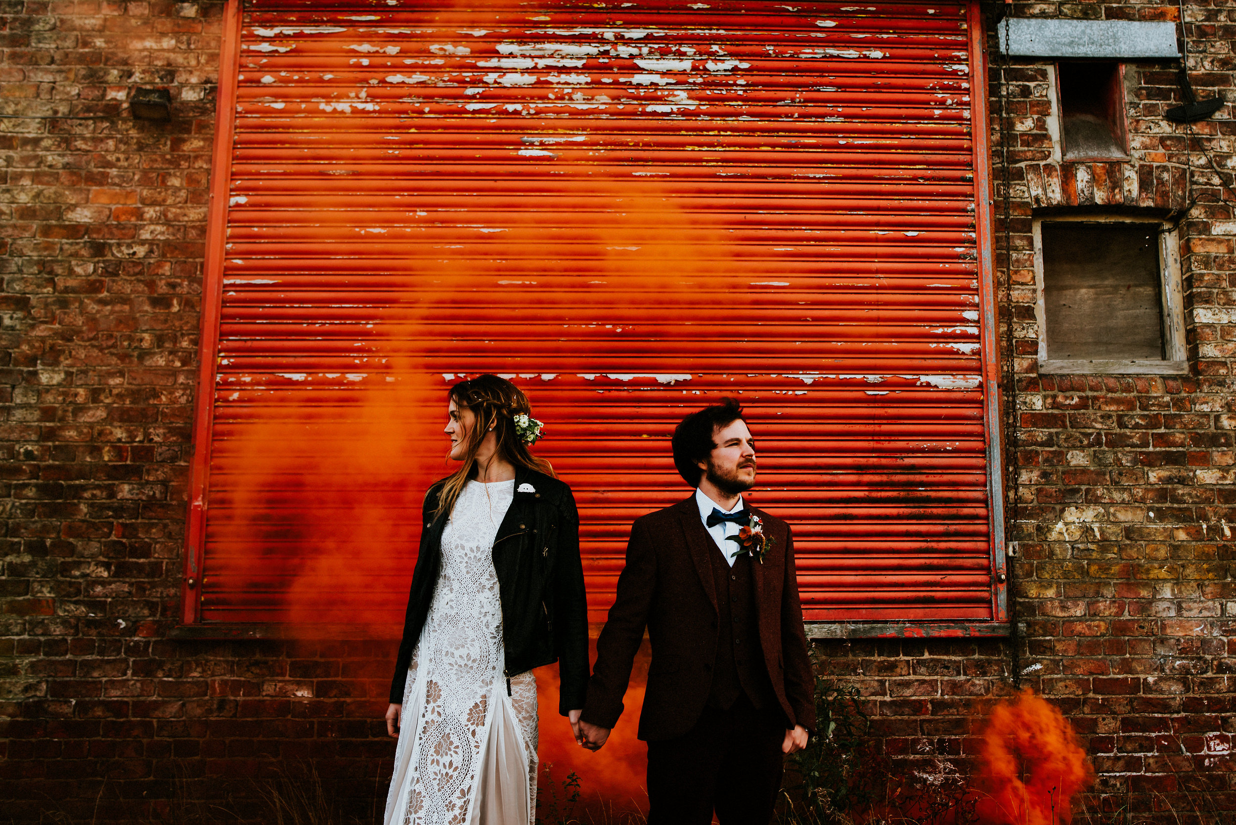 Leather jackets, Smoke Bombs, Colourful Contrast, From the York Walls to the Spotted Ox in Tockwith. Stef & Lewis' wedding was all about mixing contemporary creativity with classic elements