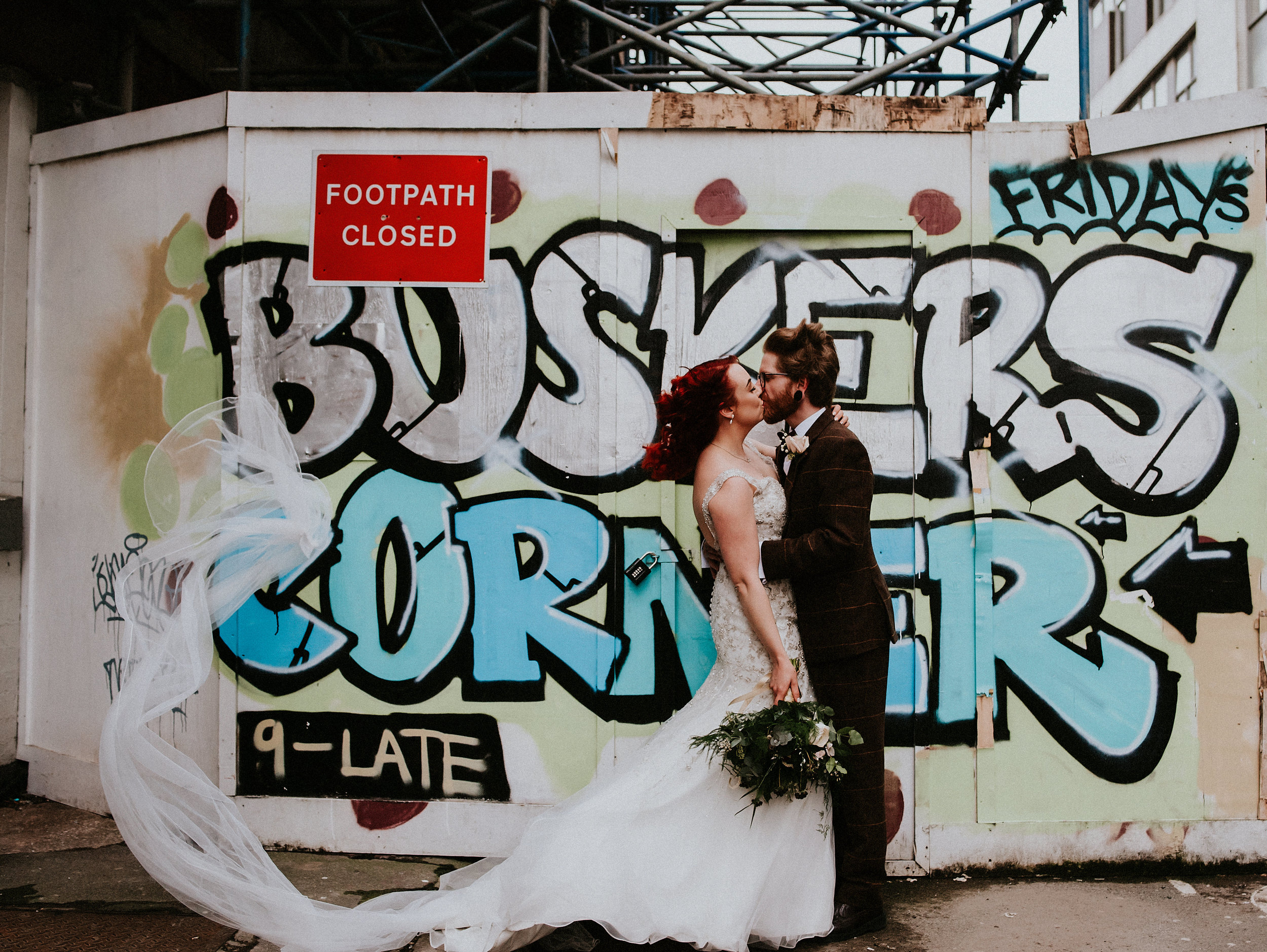Giant paper pom pom confetti, An emotion filled ceremony, Wind swept urban portraits in this Rock N Roll wedding at Cutlers Hall Sheffield.