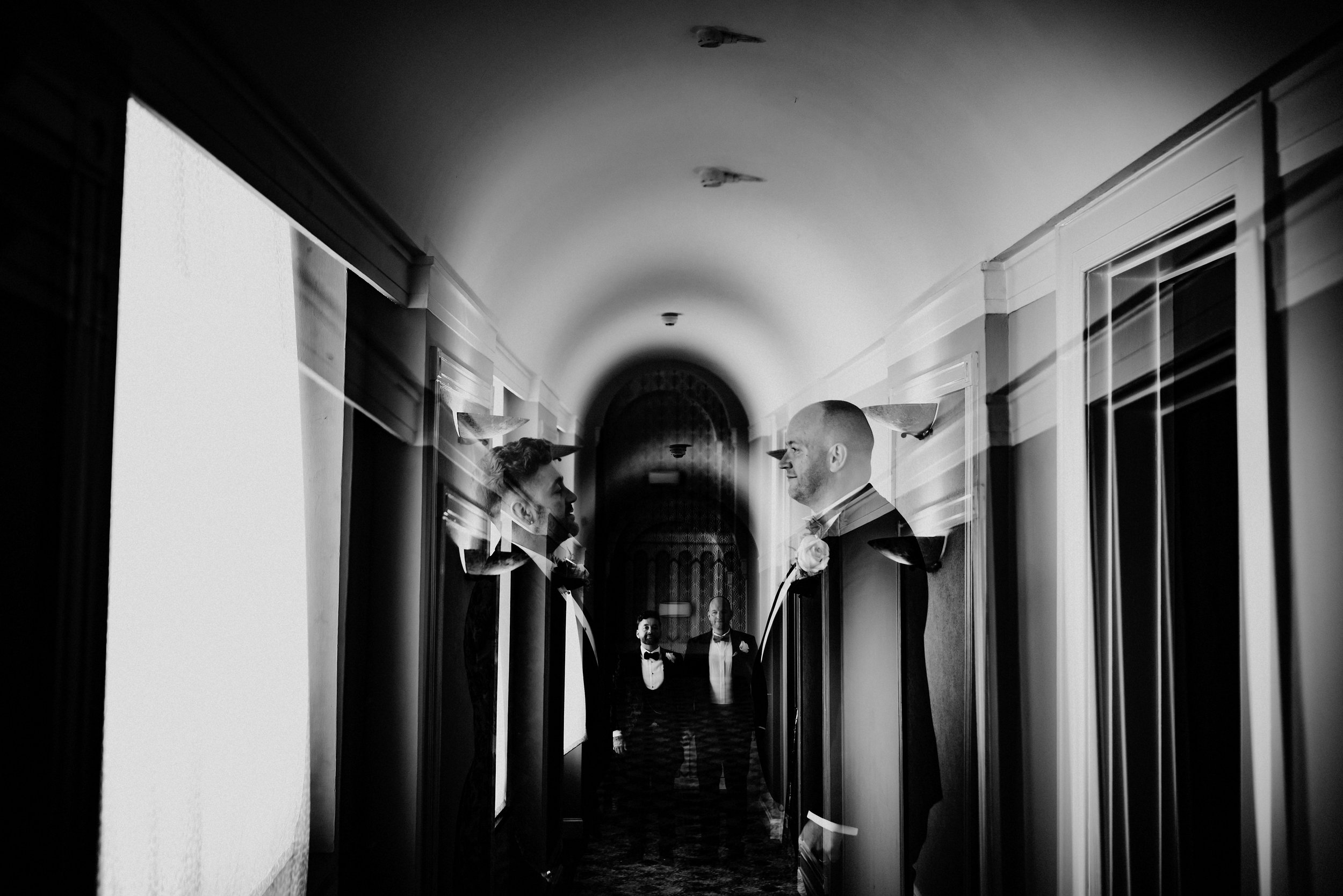 The grand hallways of the Queens Hotel in Leeds are home to the incredible Lee & Gav's day in this alternative city centre wedding filled with Art Deco vibes