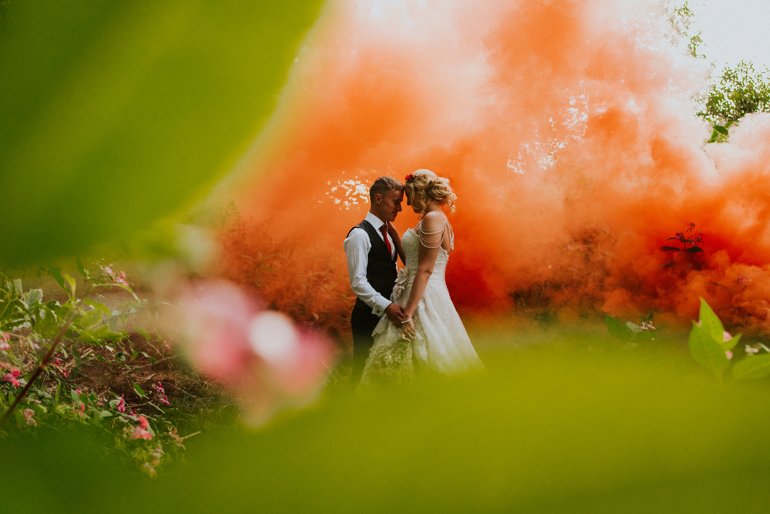 A festival themed teepee wedding meets an industrial setting of Thwaite Mills in Leeds. Smoke bombs, eclectic portraits & a killer party combine amidst true love in the fading light of Summer.