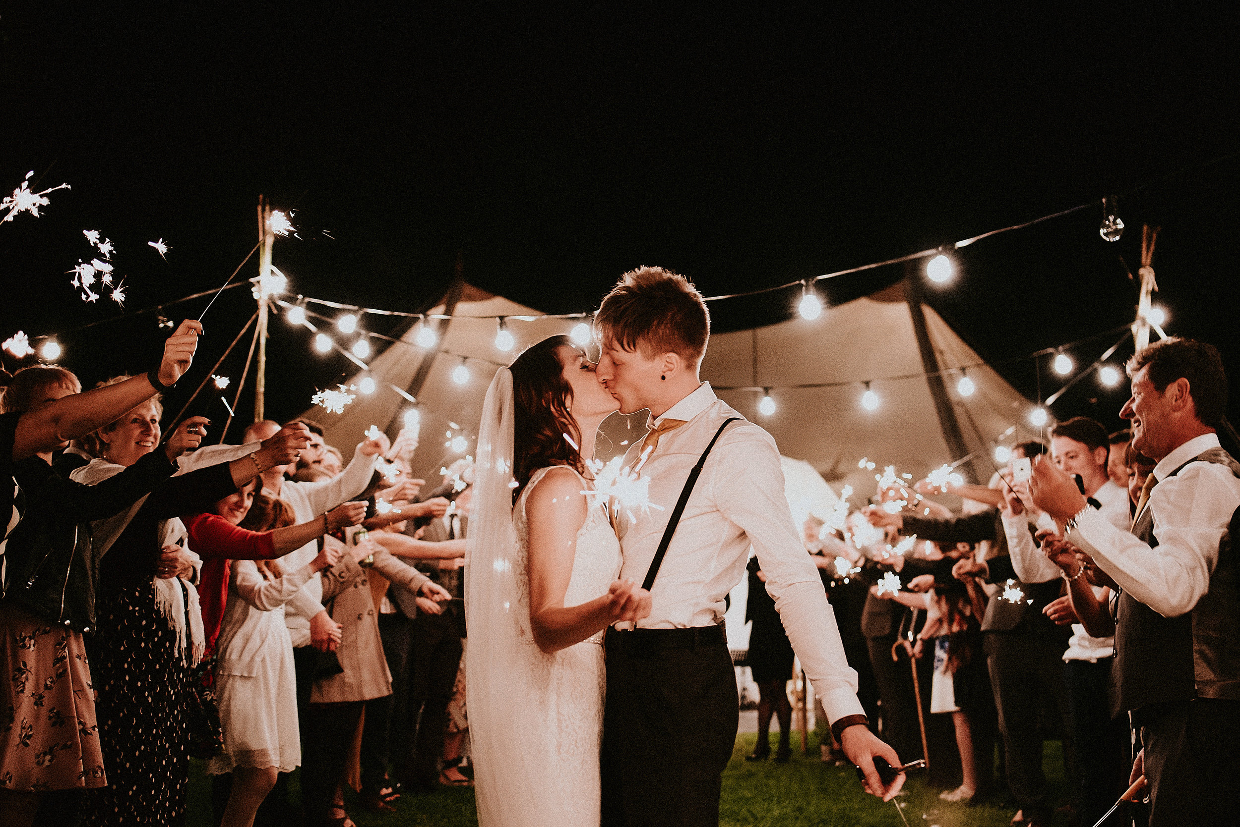 Hand made signage, an woodland ceremony. Hula hoops to sparklers lead the way to a coreographed first dance to end all first dances. In this festival themed Braisty Estate wedding featured on Junebug.
