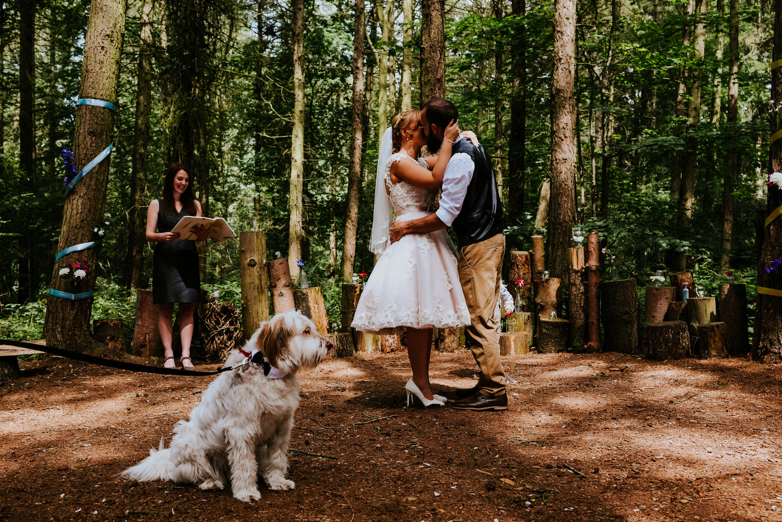 An outdoor woodland ceremony, Creative portraits amidst the Yorkshire landscape, Magical light & colourful barn details in this Camp Katur alternative wedding for Mia & John.