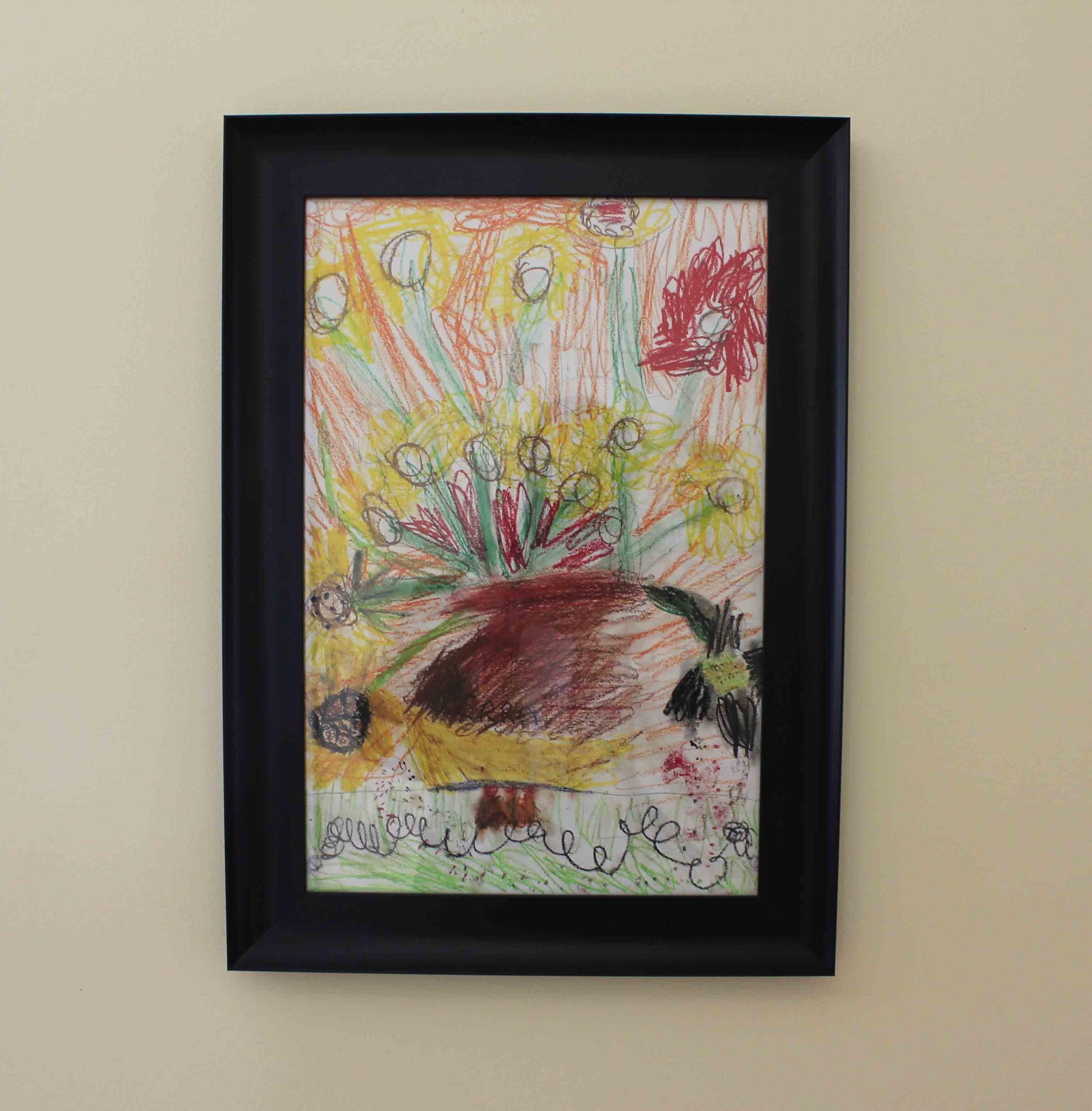 This is one of my favorite pieces on my main floor, crayon on paper, by Sierra Allen (my daughter age 5 at the time).
