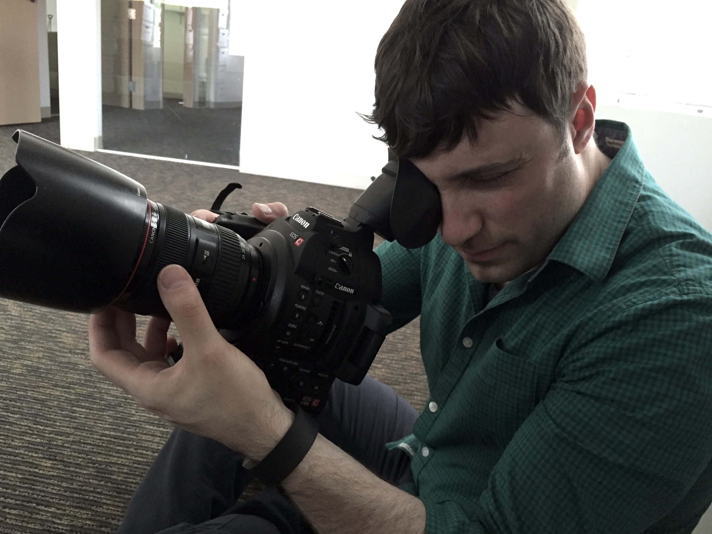 For low-angle shots, the camera can be carefully stabilized between the knee and the pressure against the viewfinder.