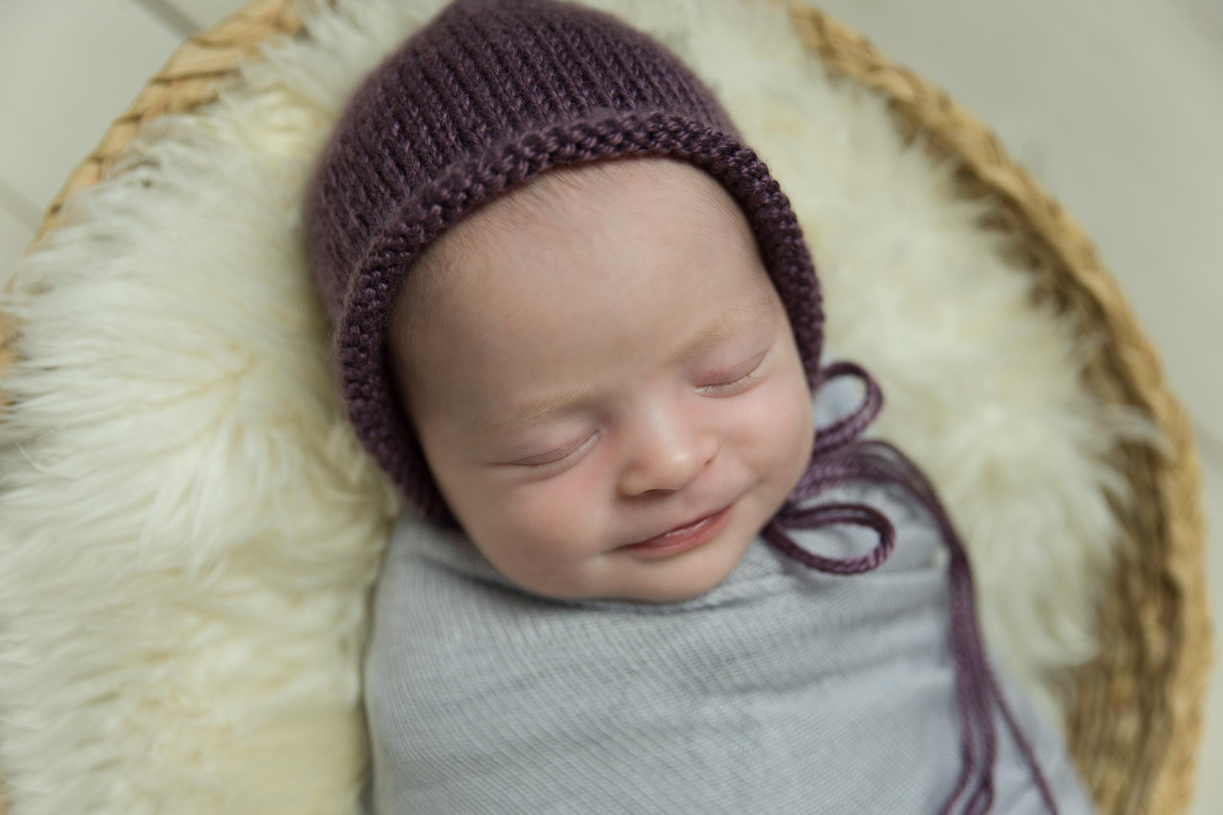 smiling girl in purple hat