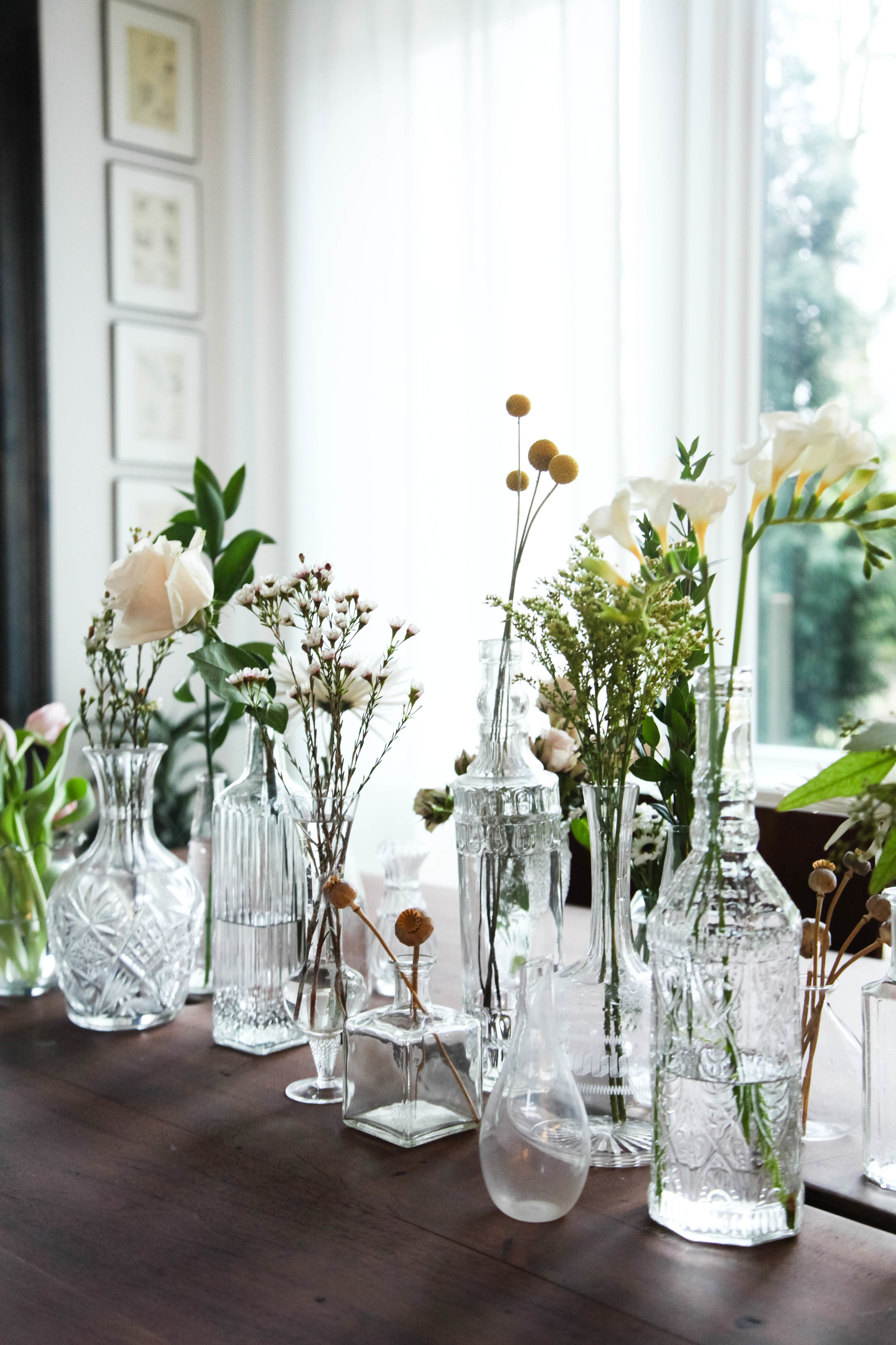 Style tip: Display collection of glass vases and bottles on a dining table. Place flowers into them. The natural light reflecting the glass is so pretty!
