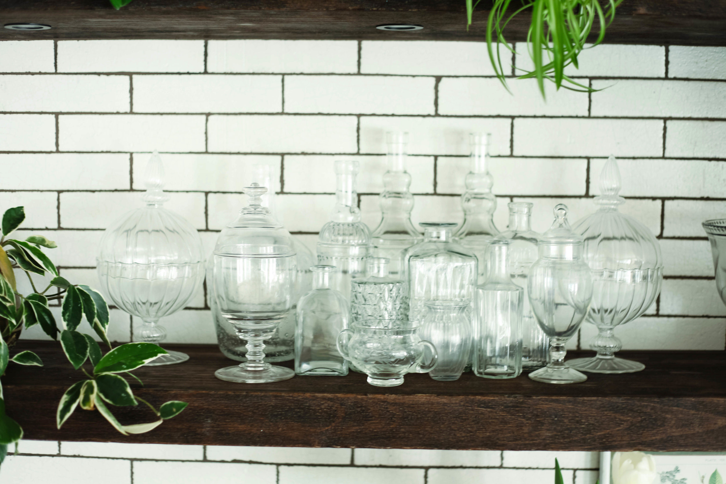 Style tip: Display a pretty collection of vintage glass bottles and vases. This adds delicate, picturesque, character and debt to a shelf.