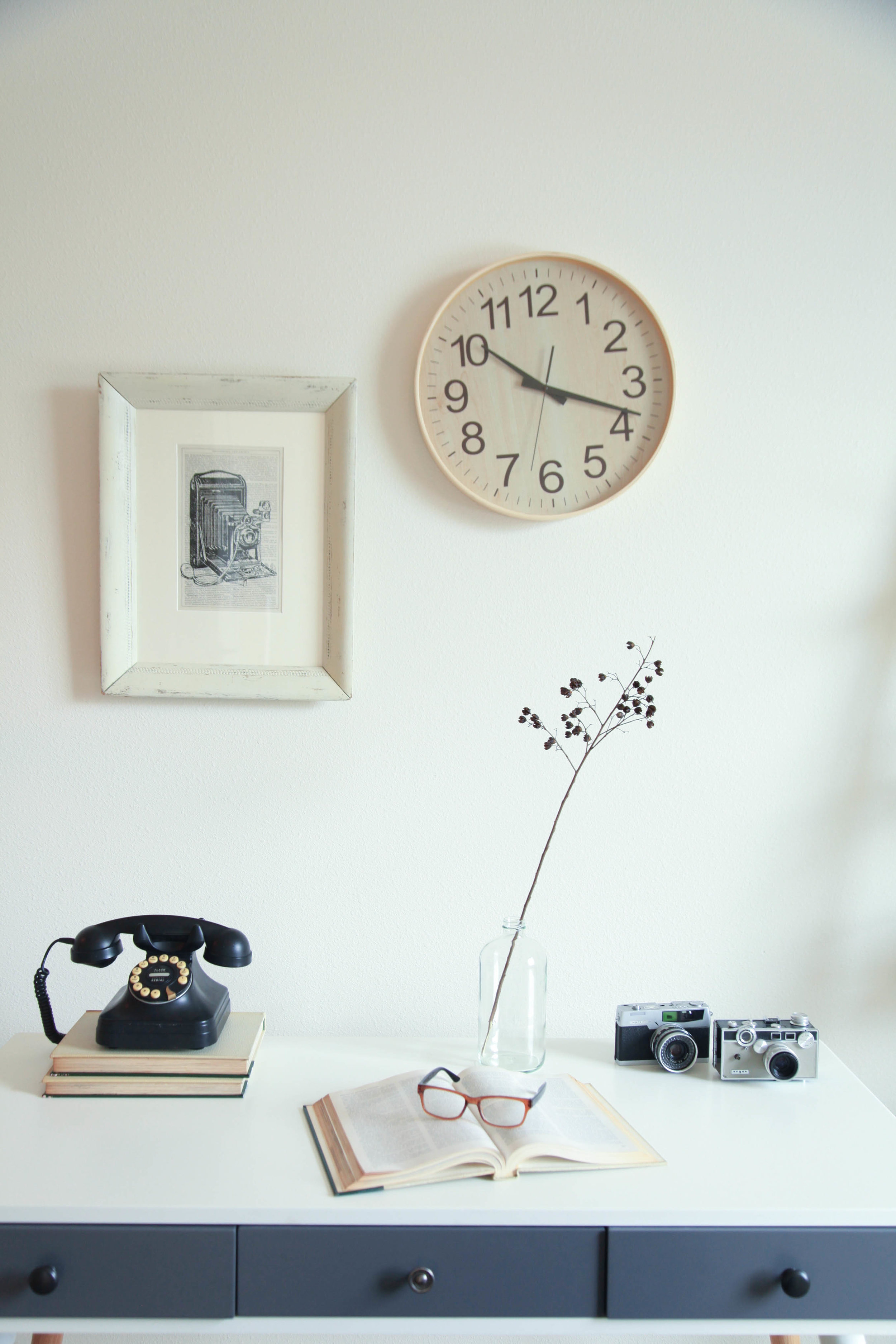 Accessorize with vintage items such as a phone and cameras