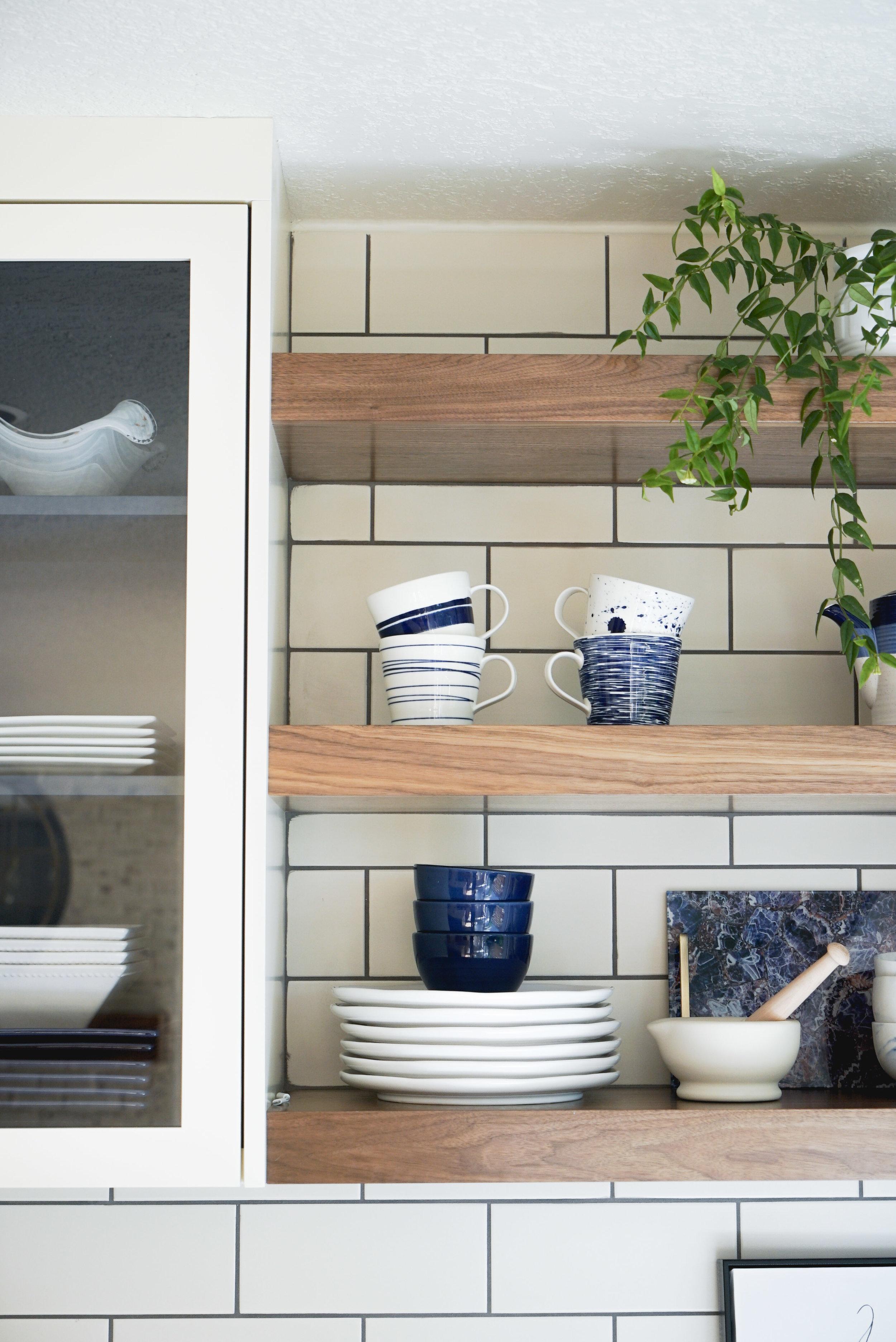 Blue details through out the kitchen shelves
