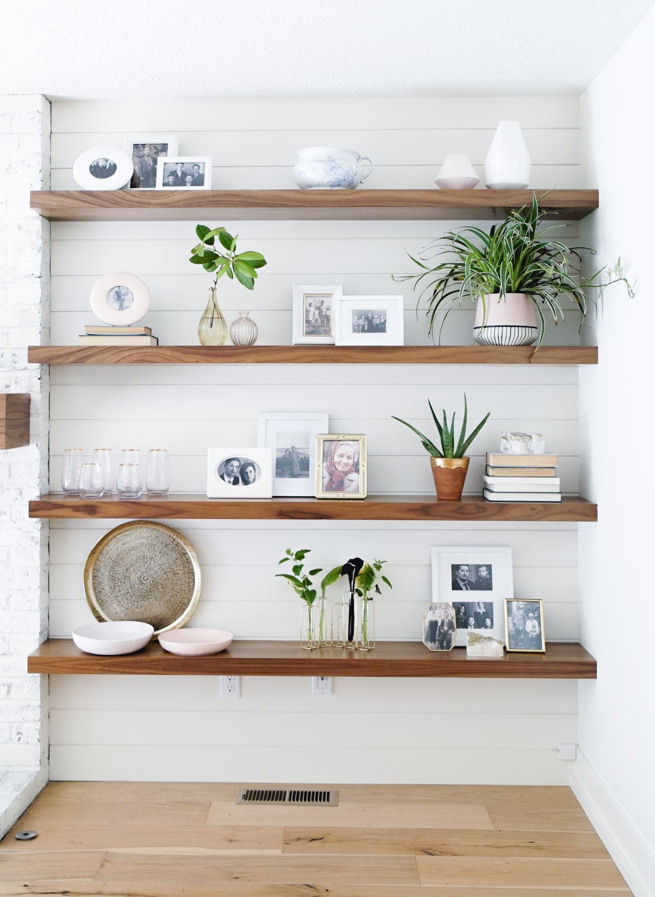 My sweet client, which happens to be my mother in law wanted to incorporate black & white photos of her parents and family on these open shelves. With a few plants and books this shelfie turned out to be so cute!