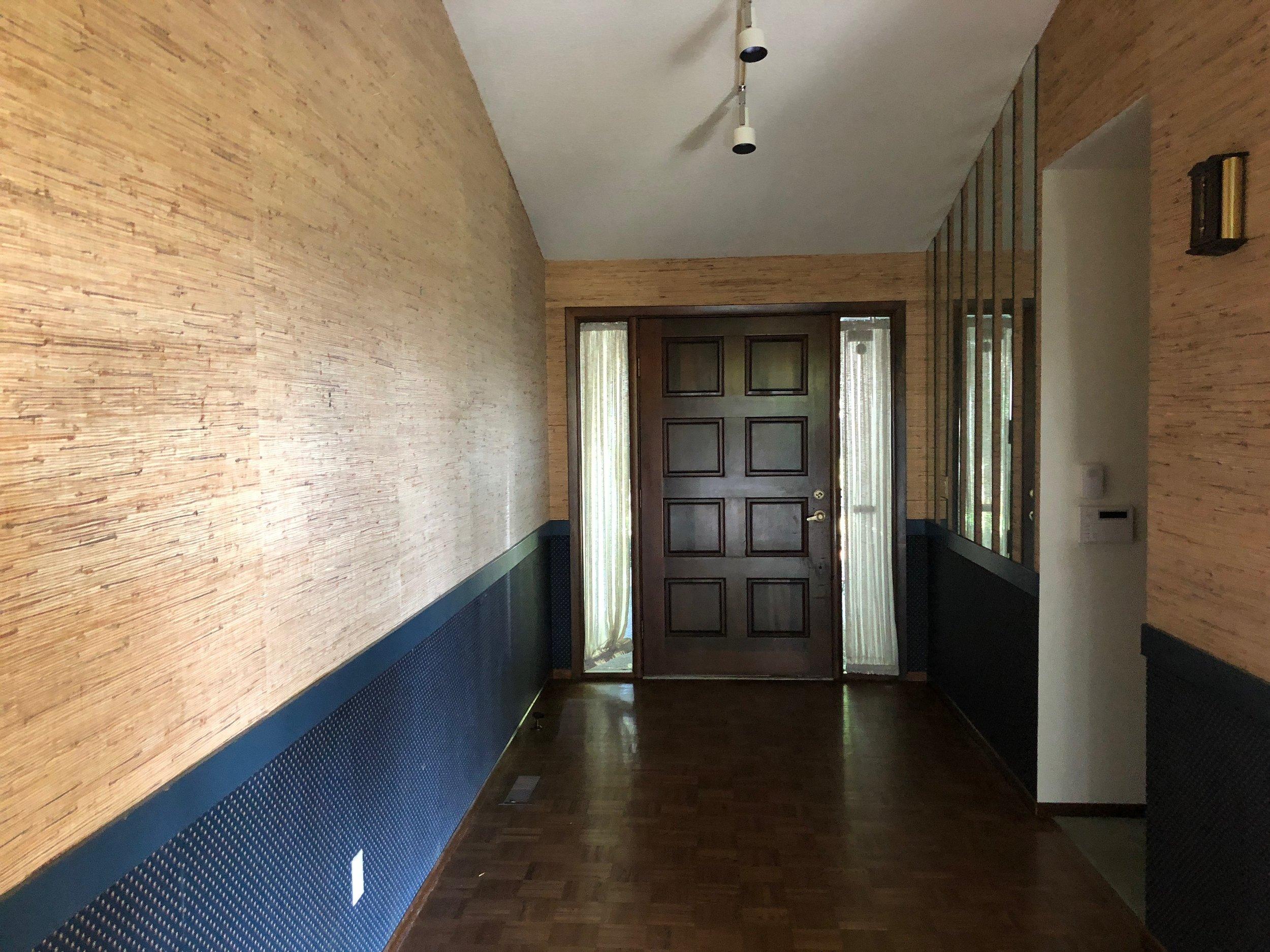 BEFORE // Entryway had woven textured walls, odd mirrors, dark floors, dark door