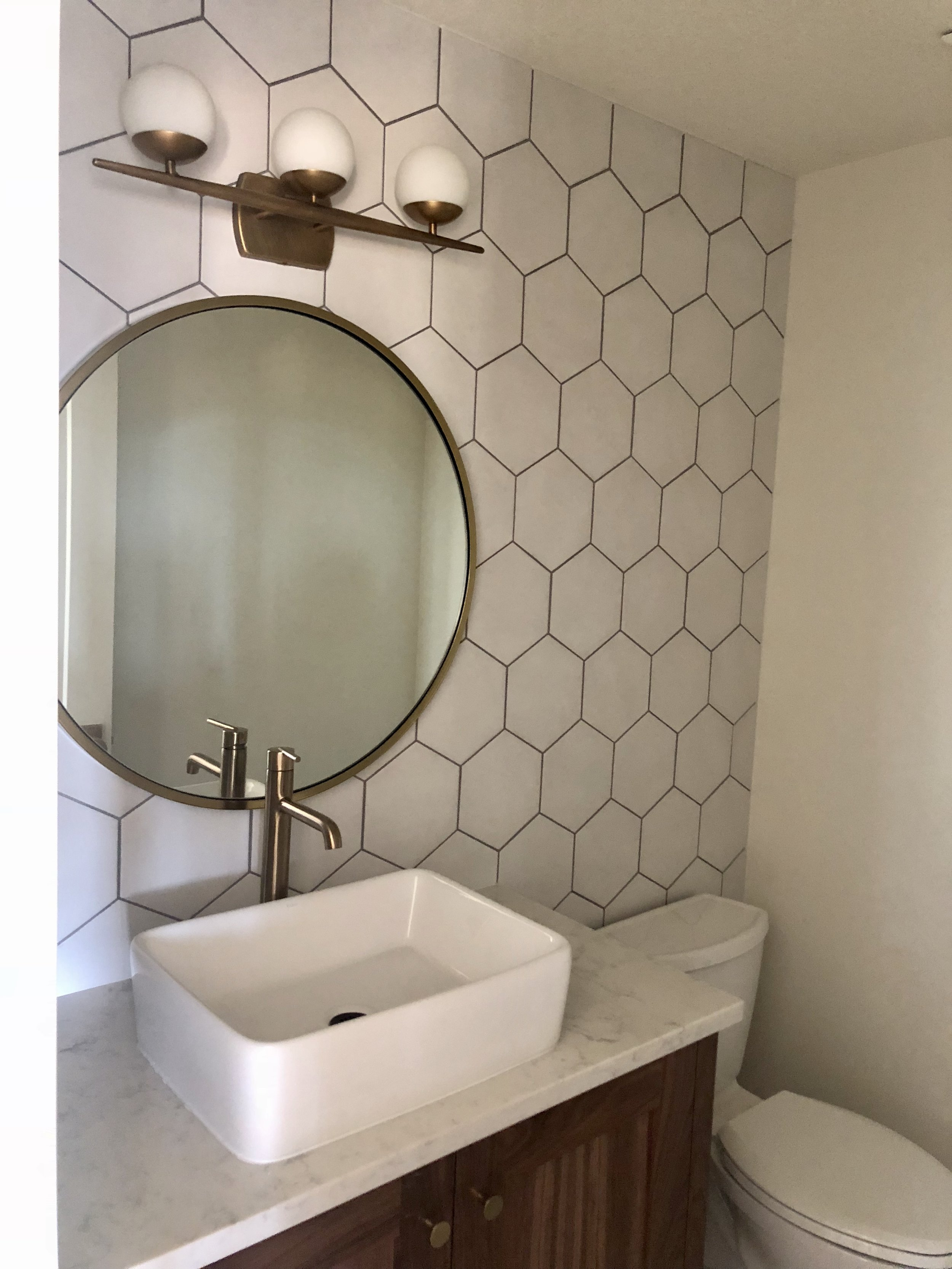 I wish I had a photo of a before powder bath, but it was very dark, outdated with green toilet. This is the AFTER! Client knew what she wanted! She has great taste.