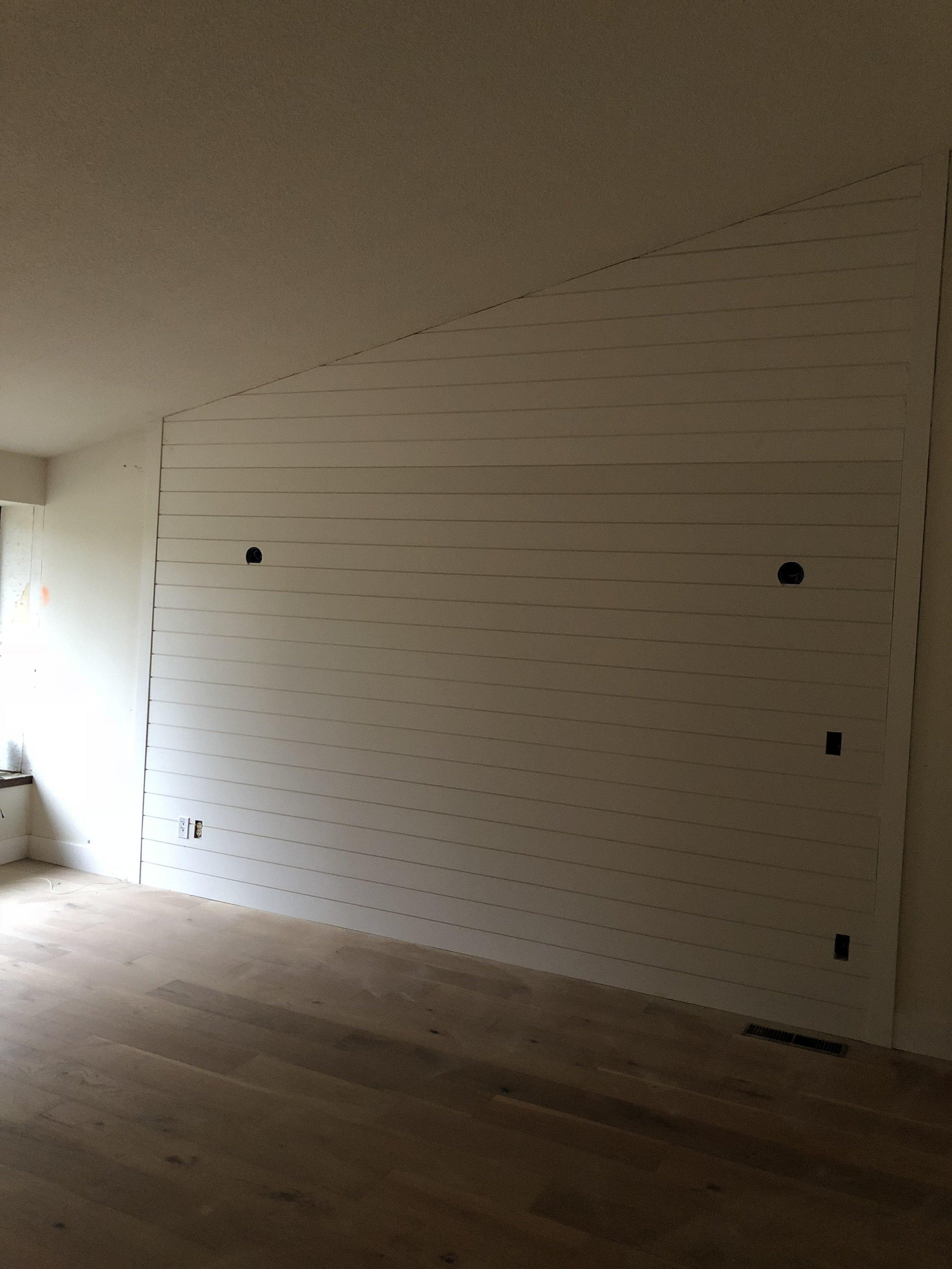 Added hardwoods, shiplap, new paint, wall light fixtures