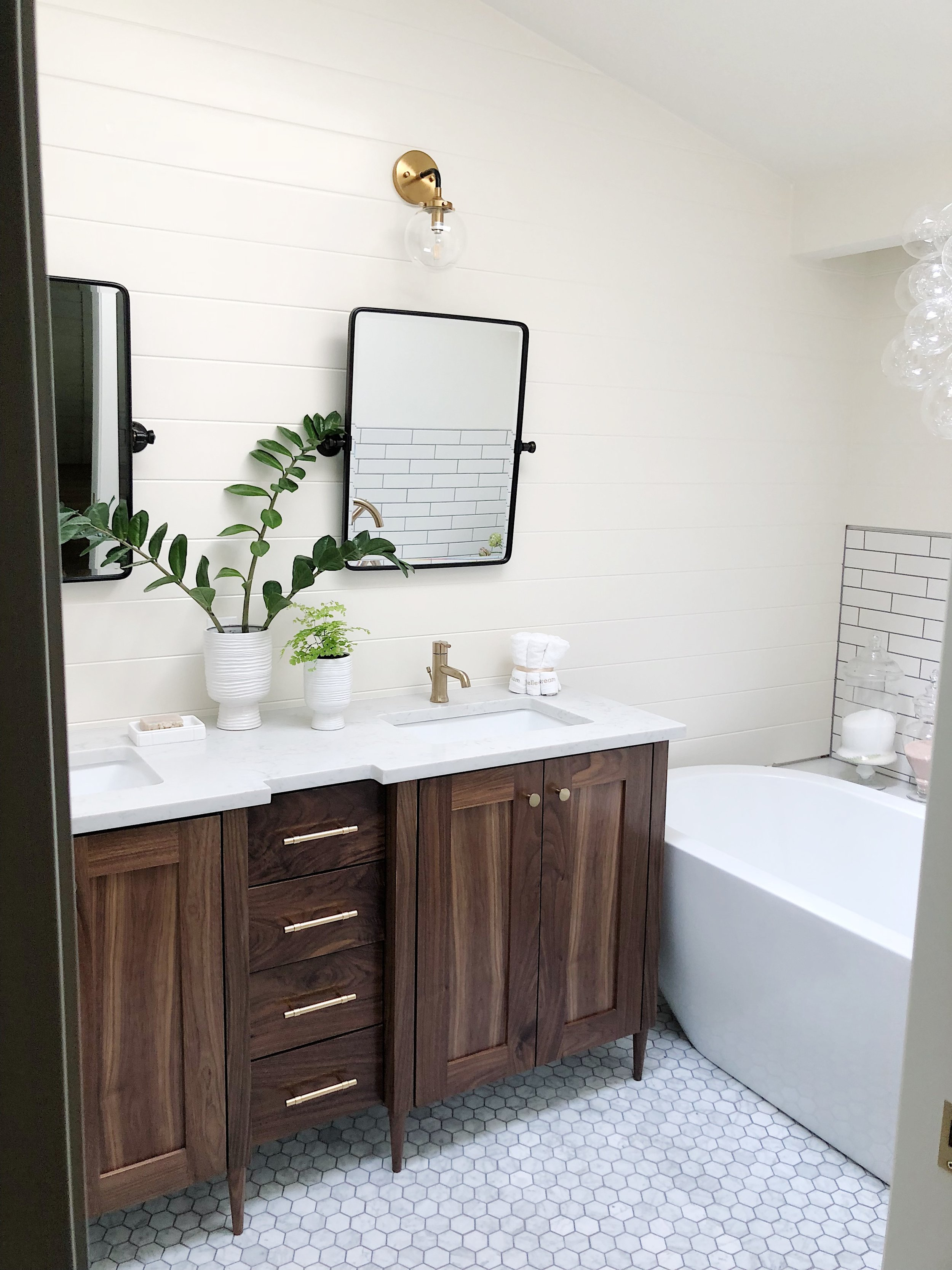 AFTER // Brand new Cabinets, sinks, faucets, lighting, tub, floor, shiplap