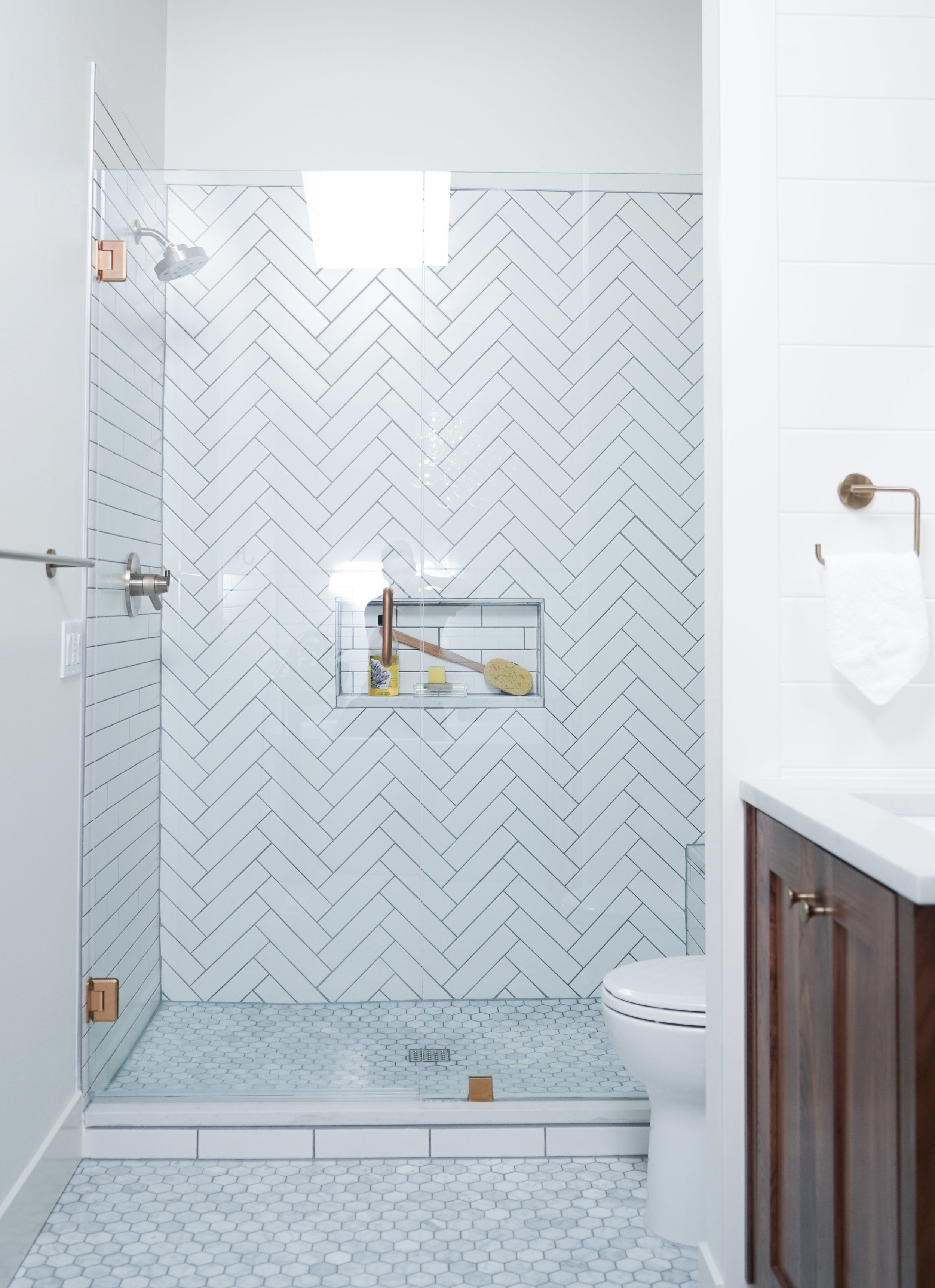 AFTER // Beautiful hexagon flooring, and traditional herringbone shower tile.