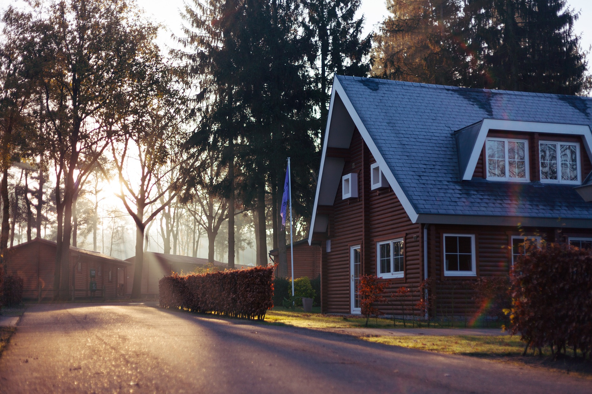 image of house with sunlight and trees