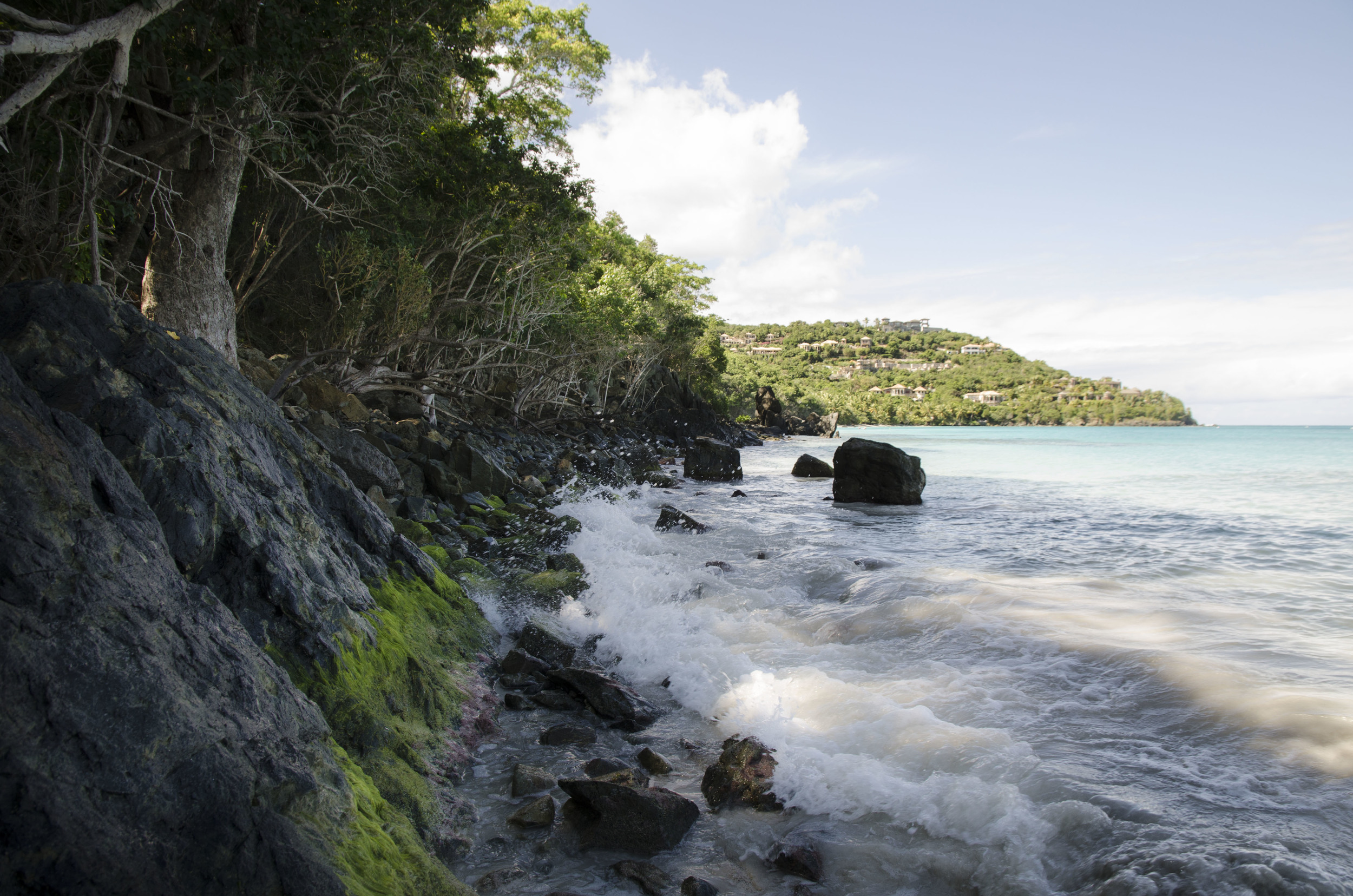 Water splashes against the rocks of Cinnamon Bay, U.S. Virgin Islands