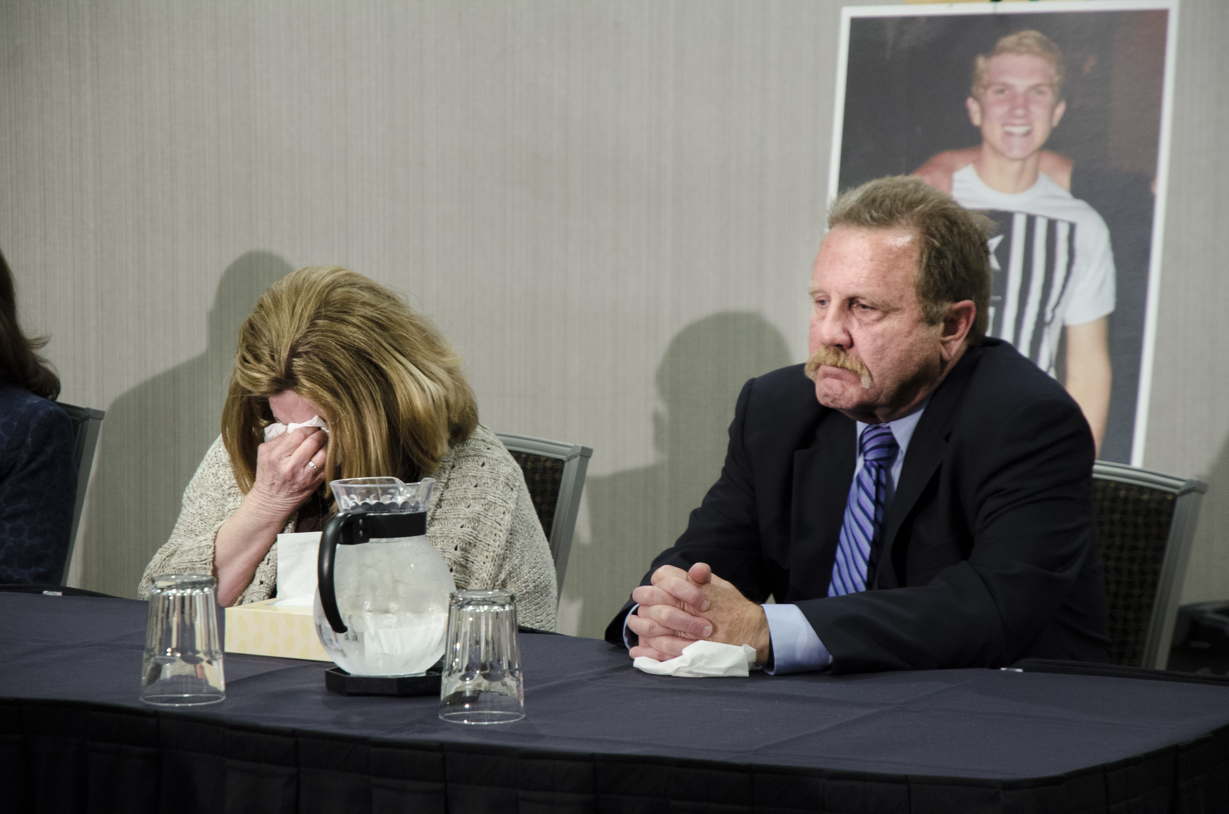 Gina McMillan-Weese sits next to Ryan's father Walter McMillan as she covers her face and cries during the news conference held by their attorneys on February 23, 2016 in Denton, Texas.