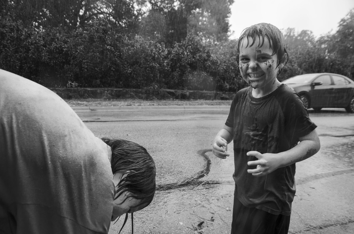 Two children play in the North Texas rain.