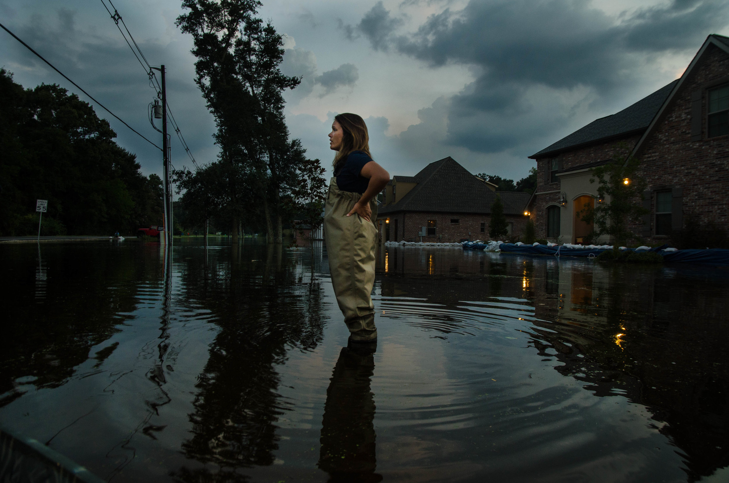 Glenda Mora, a homeowner on Bluff Rd in Baton Rouge, Louisiana, looks out over the neighborhood.