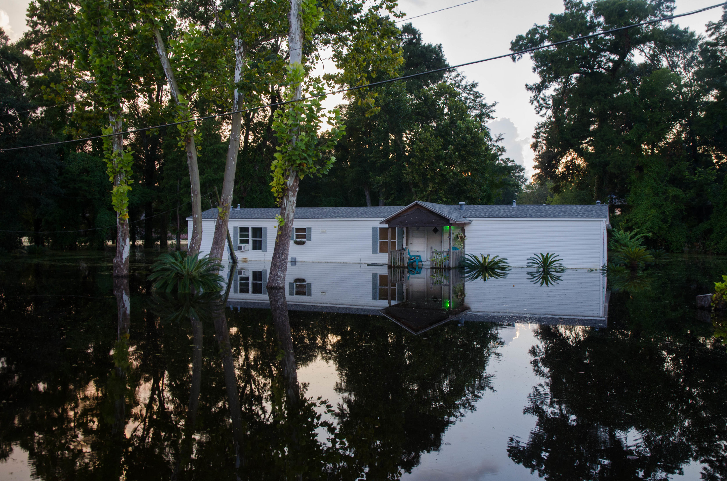 On Bluff Road a house still sits 6 feet underwater, eight days after Baton Rouge flooded.