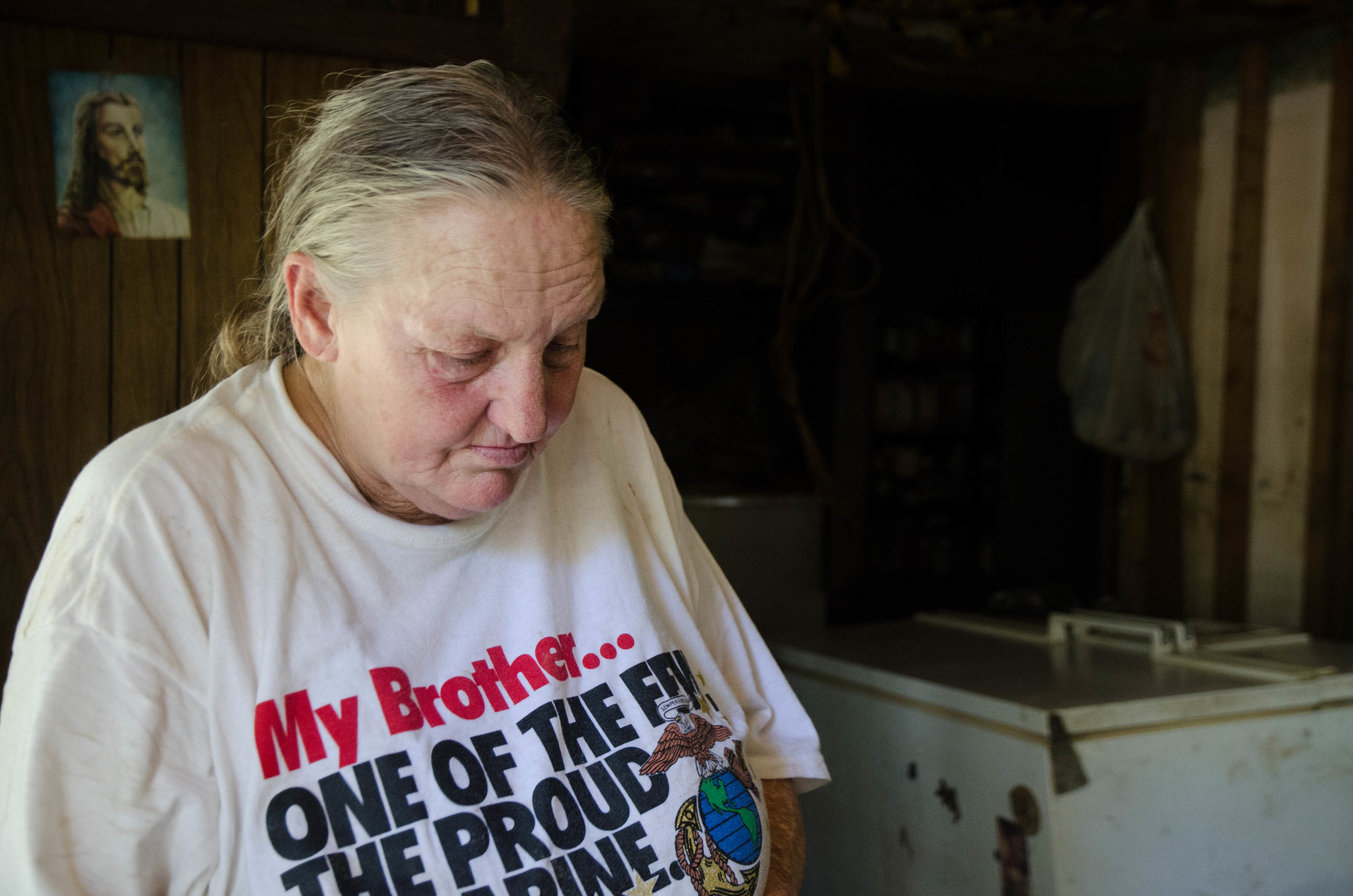 Diane Andrews looks inside her Baton Rouge home after the flood.