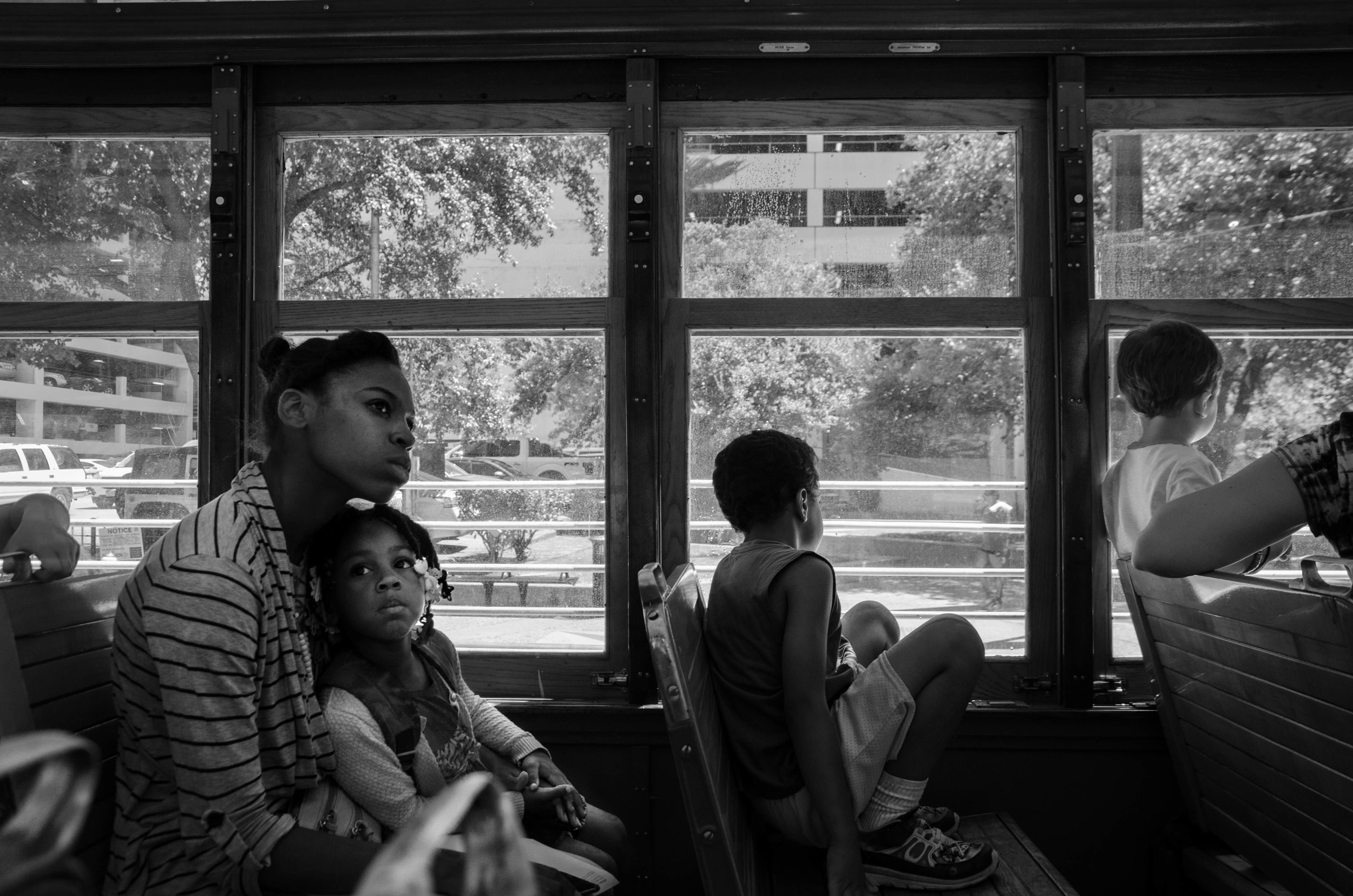 Two young women ride the trolley in Dallas, Texas.