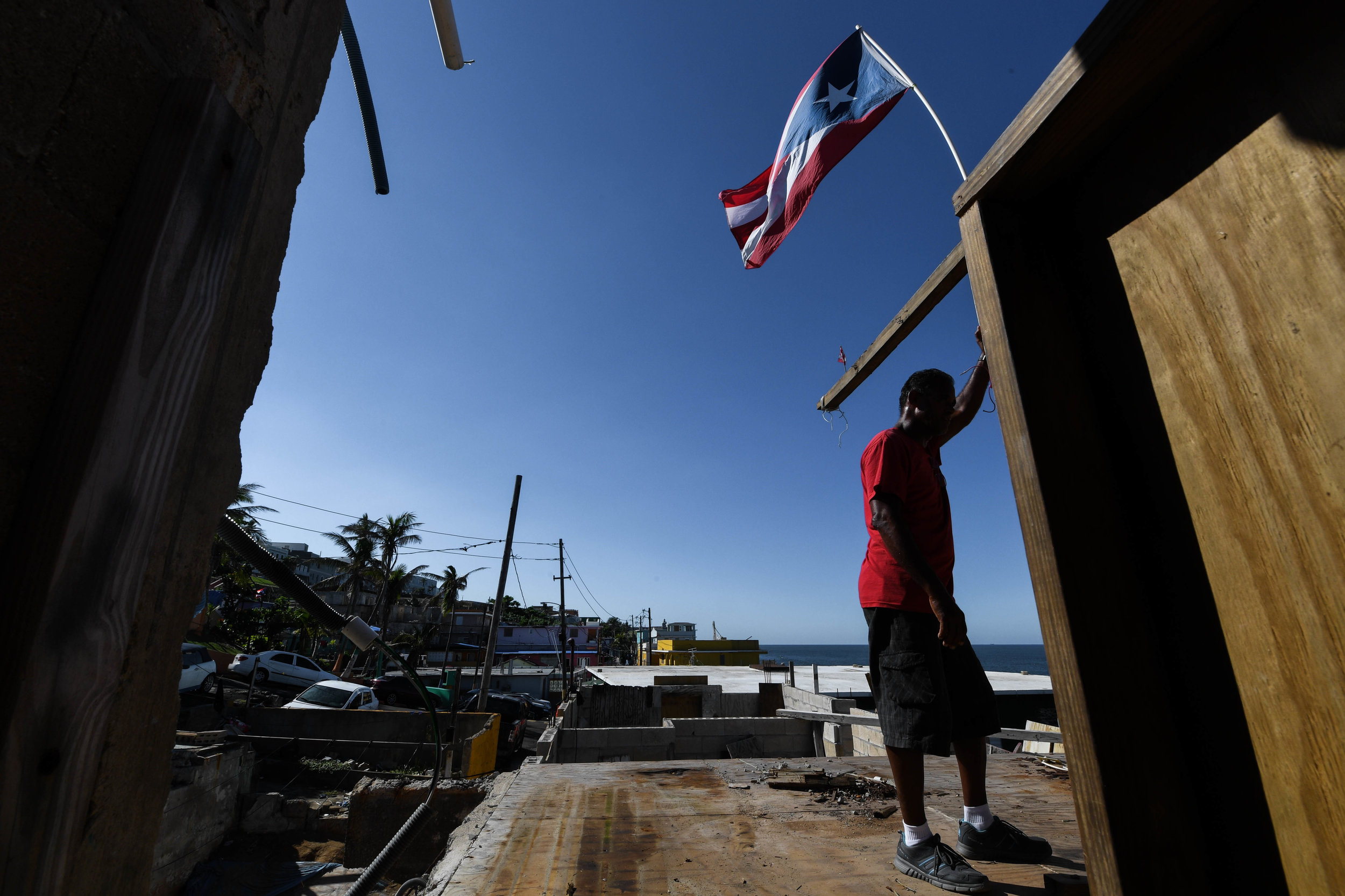 "Roberto Virbuet, 55, takes a break from rebuilding his home in La Perla, Puerto Rico. Virbuet is unsure if he can continue living in Puerto Rico after Hurricane Maria. ""This is not the Puerto Rico, the one I am living in, this does not feel like home,"" he said. Virbuet is the last of his family living in Puerto Rico. ""I just want to be with my brother in Florida,"" he said. Family is the only thing he wants after surviving the storm. ""I miss the music,"" Virbuet said. ""The music is different now. It is sad."" Over the past three months, Virbuet has delayed returning to his beach-front home in La Perla. When he returned, he feared Puerto Rico would never be the same. ""I have no thoughts,"" he said. ""I want my home back."""