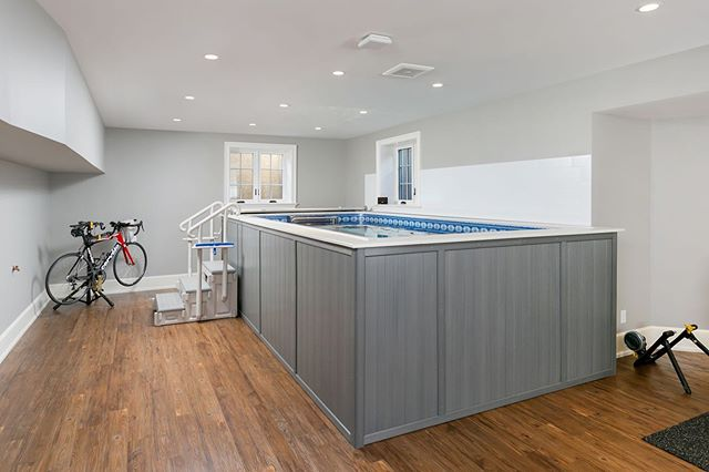 Just because summer is winding down doesn't mean swimming has to stop. This custom 5 bed/5 bath dream home in Berwyn included an indoor endless pool, enabling the owner's to enjoy year-round swim workouts. #mainlinehomes #mainlinetoday #mainlinelife #mainlinehome #Homedecor, #house, #homedesign, #philly, #phillyhomes, #homesweethome, #homeconstruction, #instahome, #houserenovation, #homerenovation, #philadelphia #mainlineliving, #mainlinelife, #mainlinehomes, #phillymag, #mainlinehomerenovation #mainlinecustombuilder #buildersofinsta #homegoals