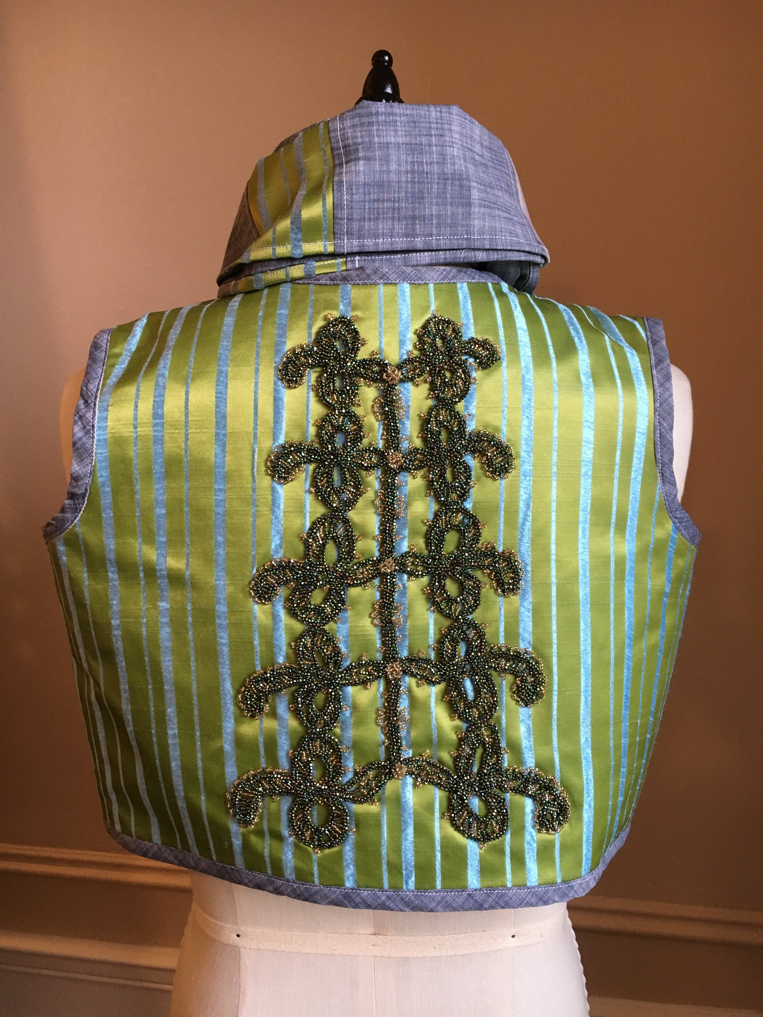 green and blue beaded vest back with scarf.JPG
