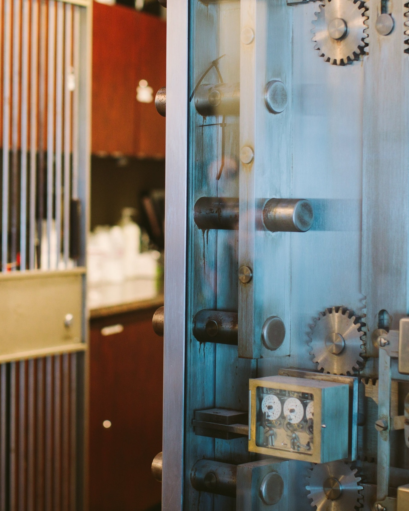 A CREATIVE SPACE - OUR BUILDING WAS ORIGINALLY A BANK THAT HAS SINCE BEEN CONVERTED INTO A SALON. THE 1970'S BANK VAULT IS NOW USED AS OUR COLOR VAULT AND MIXING STATION.