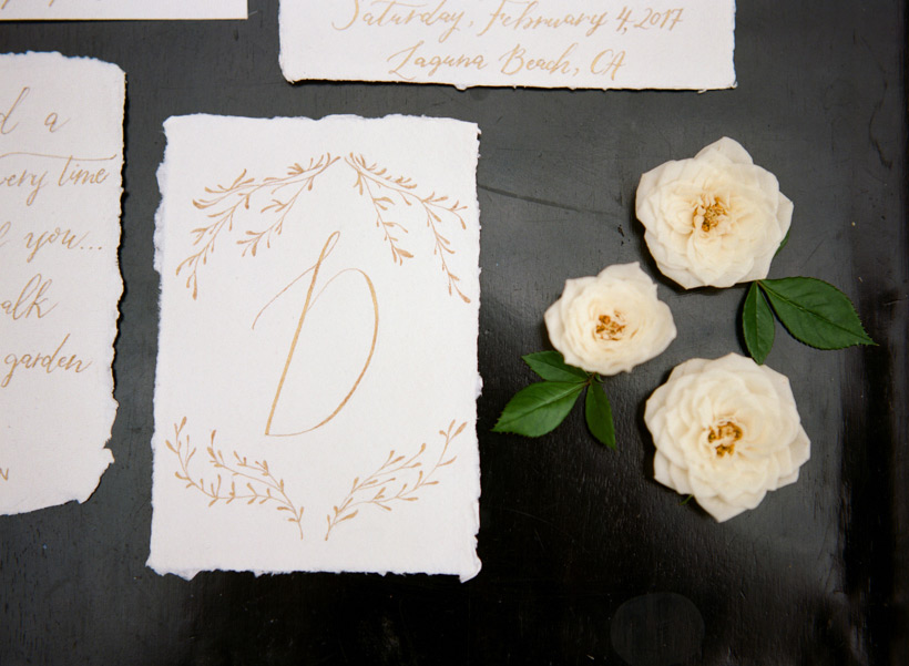 Gold calligraphy with deckled edging by Julia Rohde Designs - photo by Kat Braman