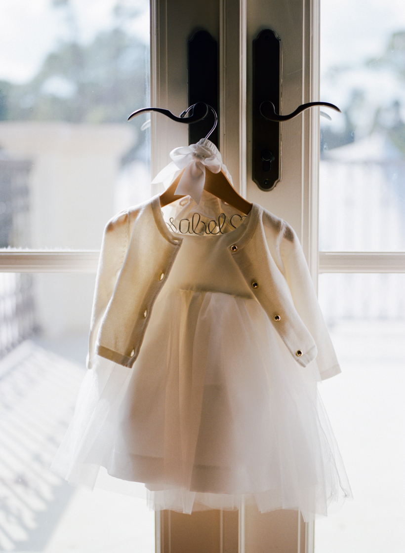 The sweetest tulle flower girl dress with cardigan and custom hanger - photo by Kat Braman