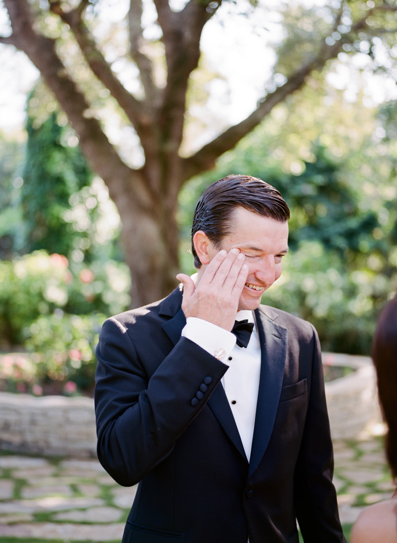 Groom cries when seeing his bride for the first time - photo by Kat Braman