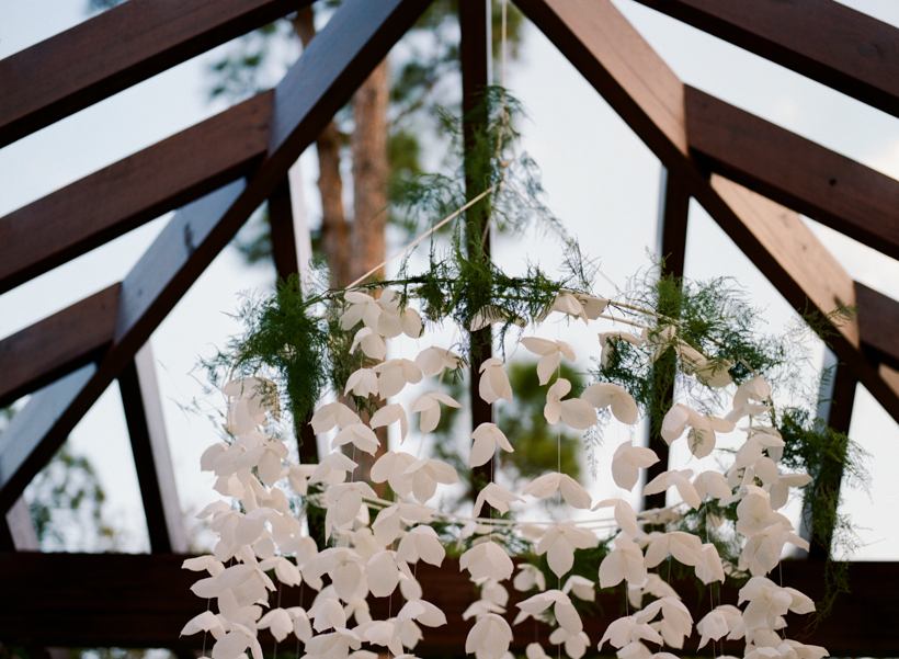 Guests were welcomed into the reception with this one of a kind paper flower chandelier created by Hayley Sheldon.  Photo by Kat Braman