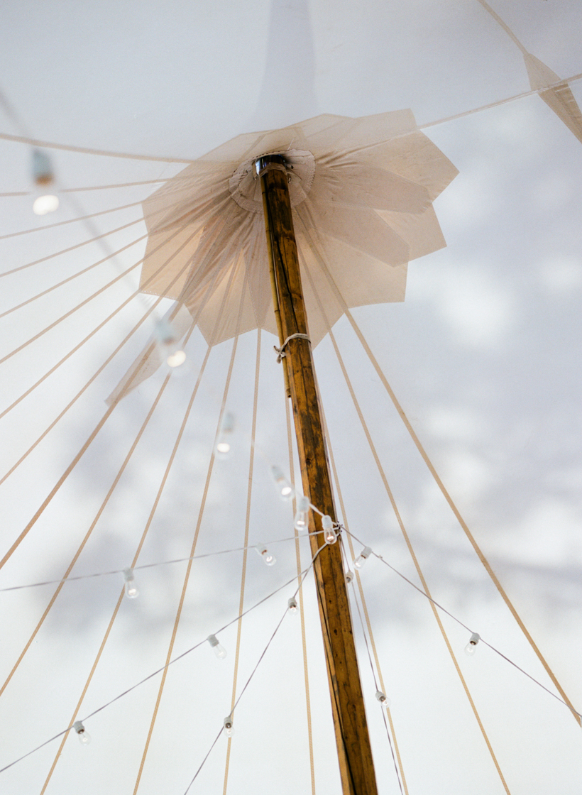 A Sperry Tent always creates such a beautiful setting for any wedding reception.  Photo by Kat Braman