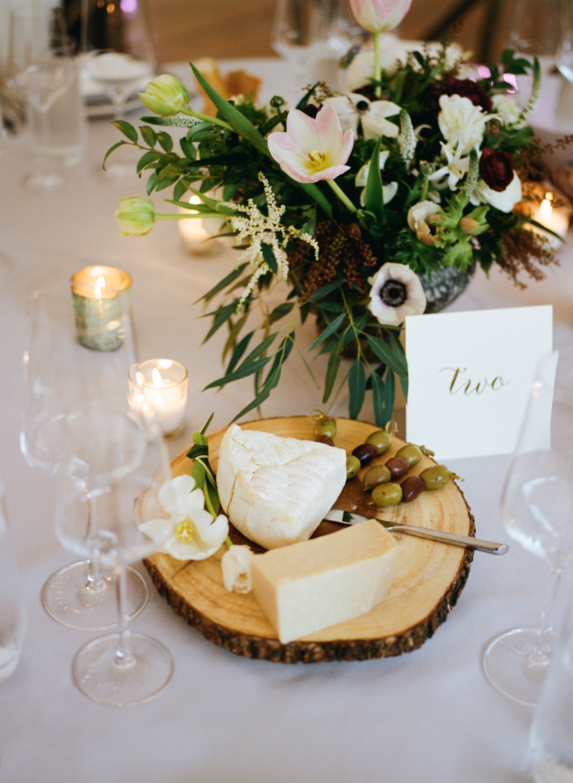 Each table was adorned with cheese and bread boards set on raw wood platters.  Photo by Kat Braman
