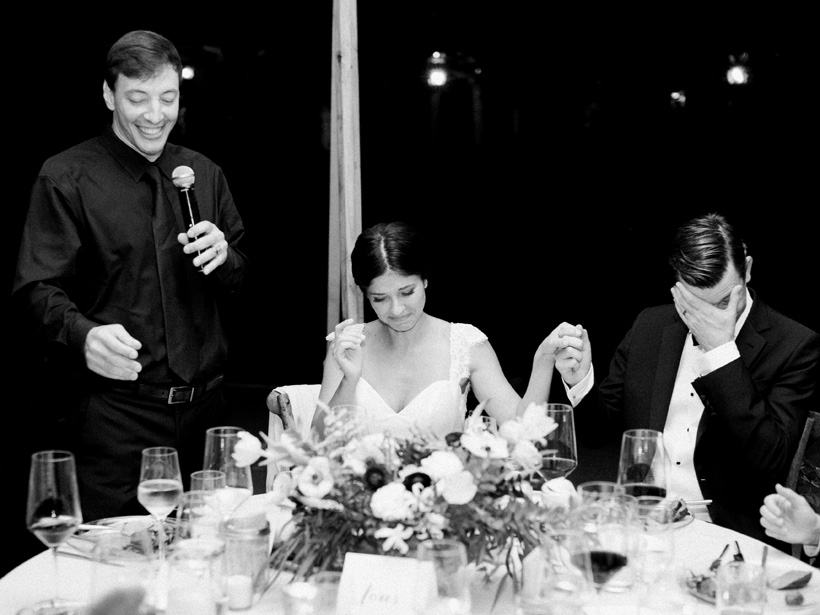 Bride and groom get emotional during her brother's wedding speech.  Photo by Kat Braman