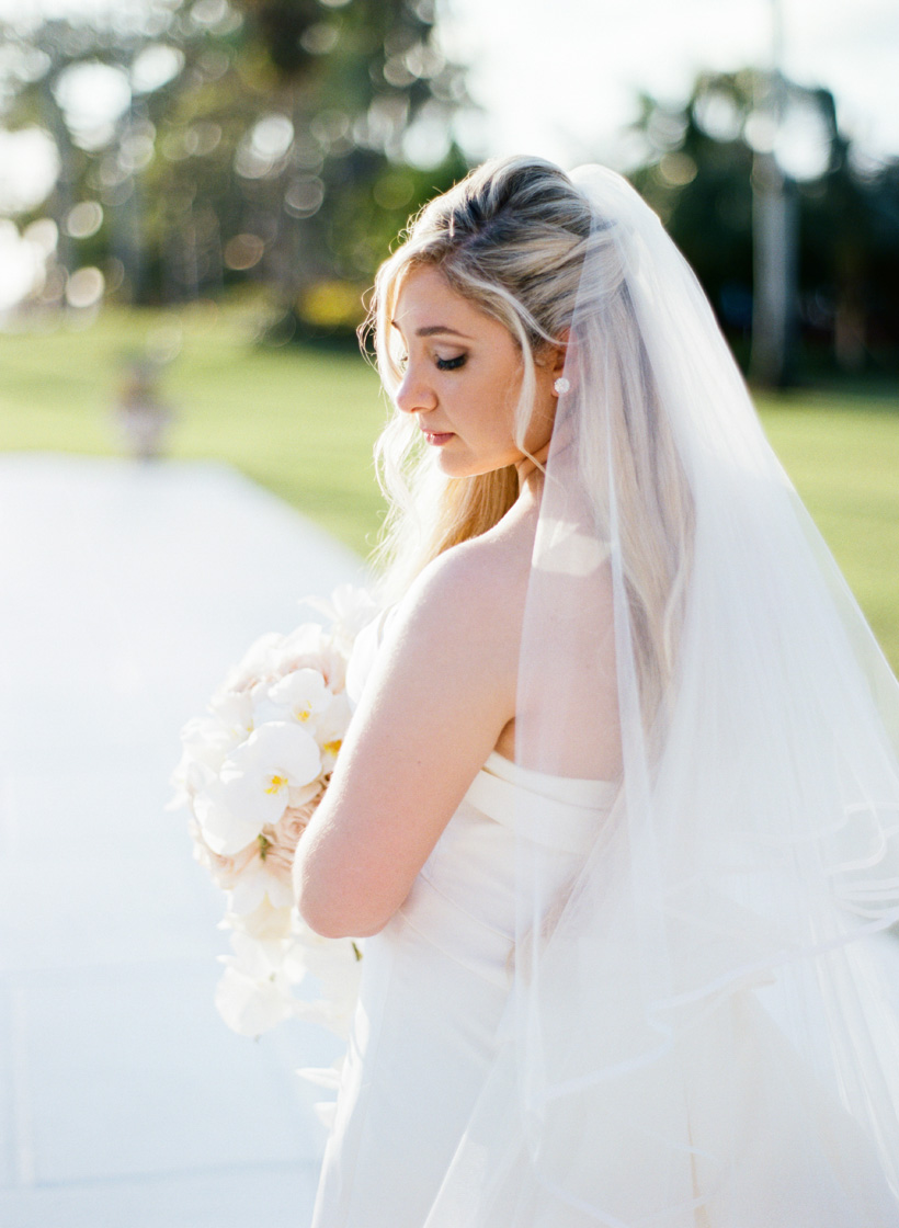 Bride wearing Carolina Herrera at the Mar-a-Lago Club in Palm Beach, Florida. Photo by Kat Braman